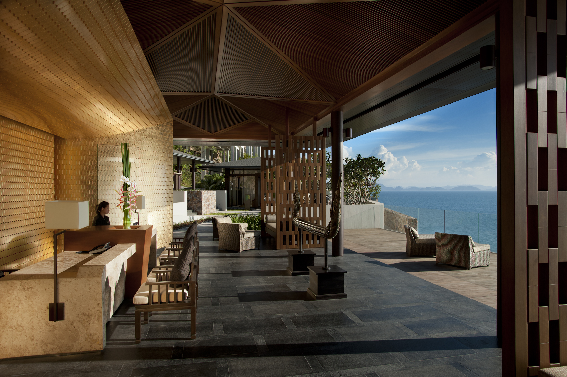 The reception desks are anchored by a welcoming backdrop that is reminiscent of a traditional Thai roof detail, very graceful in form and finished in gold-leaf. The remainder of the space is open to instill a sense of peace and tranquility.