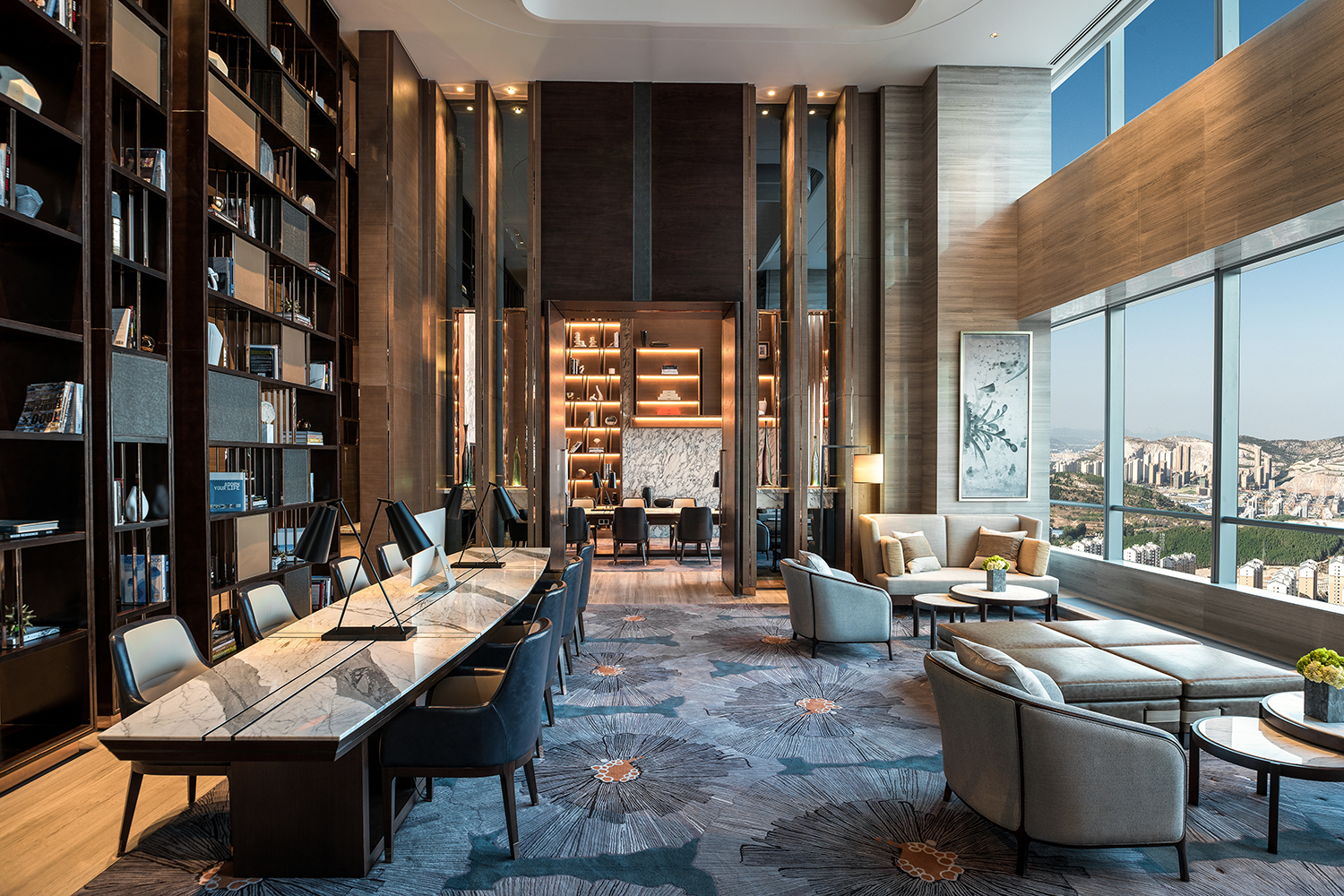 Various seating arrangements placed throughout the open lobbies are tastefully selected and configured to provide much-needed pockets of residential sanctuary to visitors.