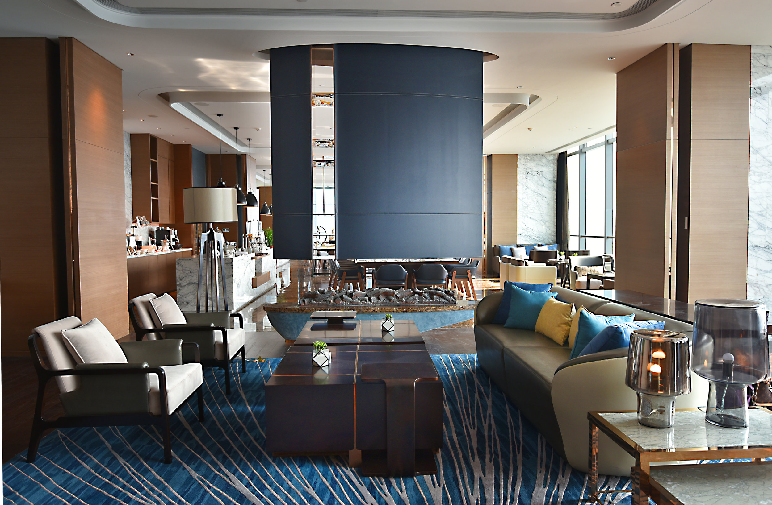 Decorative soft free-standing leather panels further layer these spaces with a nod to delicate stitching details and aquifer-inspired artwork.