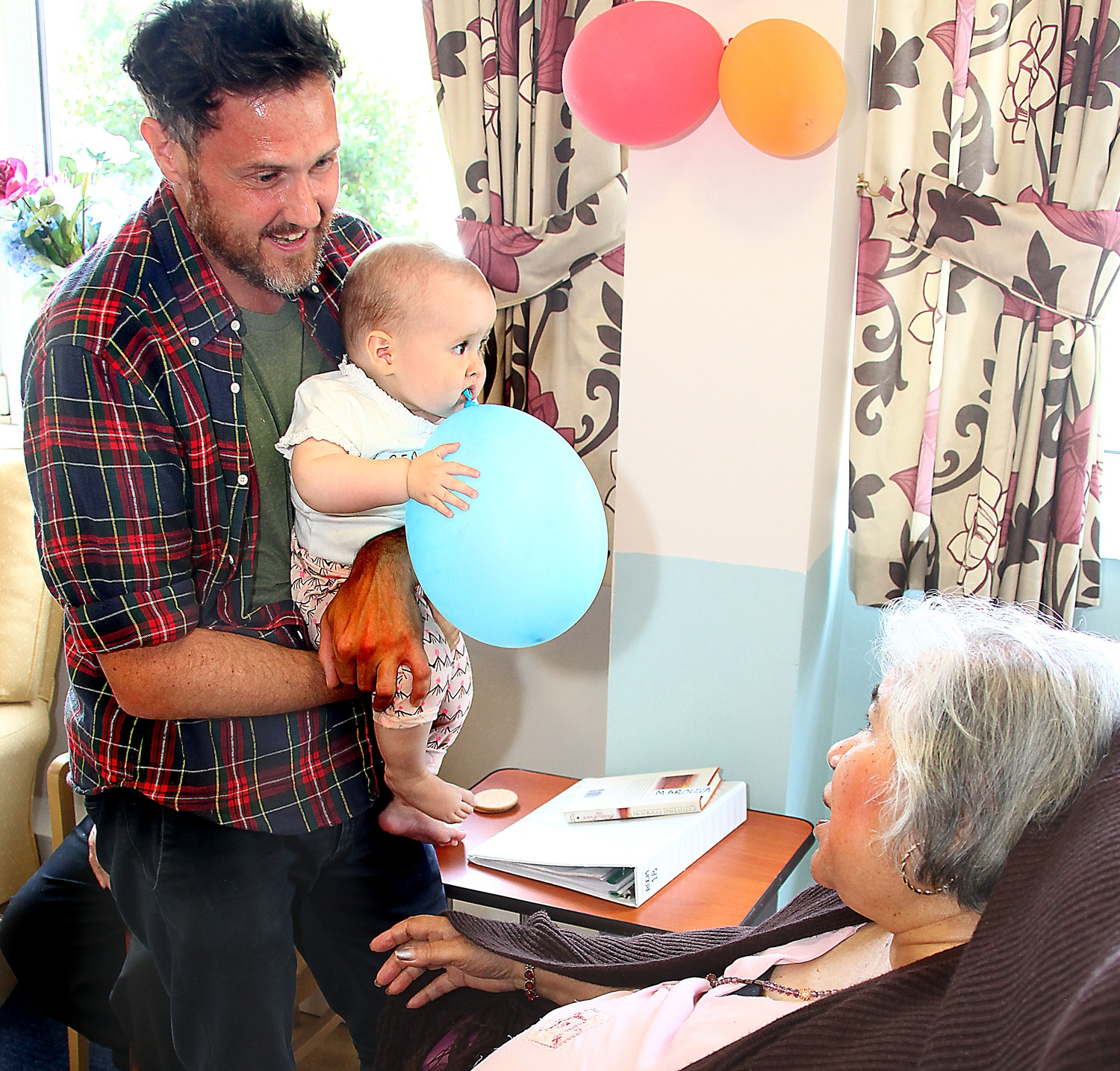 Sheila, Ross Wyld resident, with dad James and baby Beau