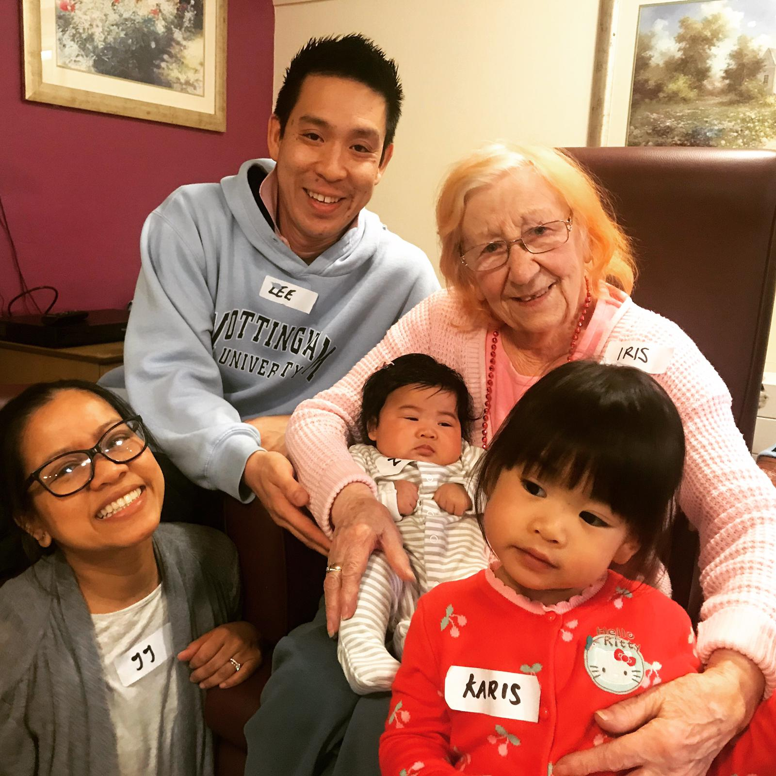 Dad Lee, mum JJ, Karis and baby Zoe getting to know Summerdale Court resident Iris at Songs & Smiles