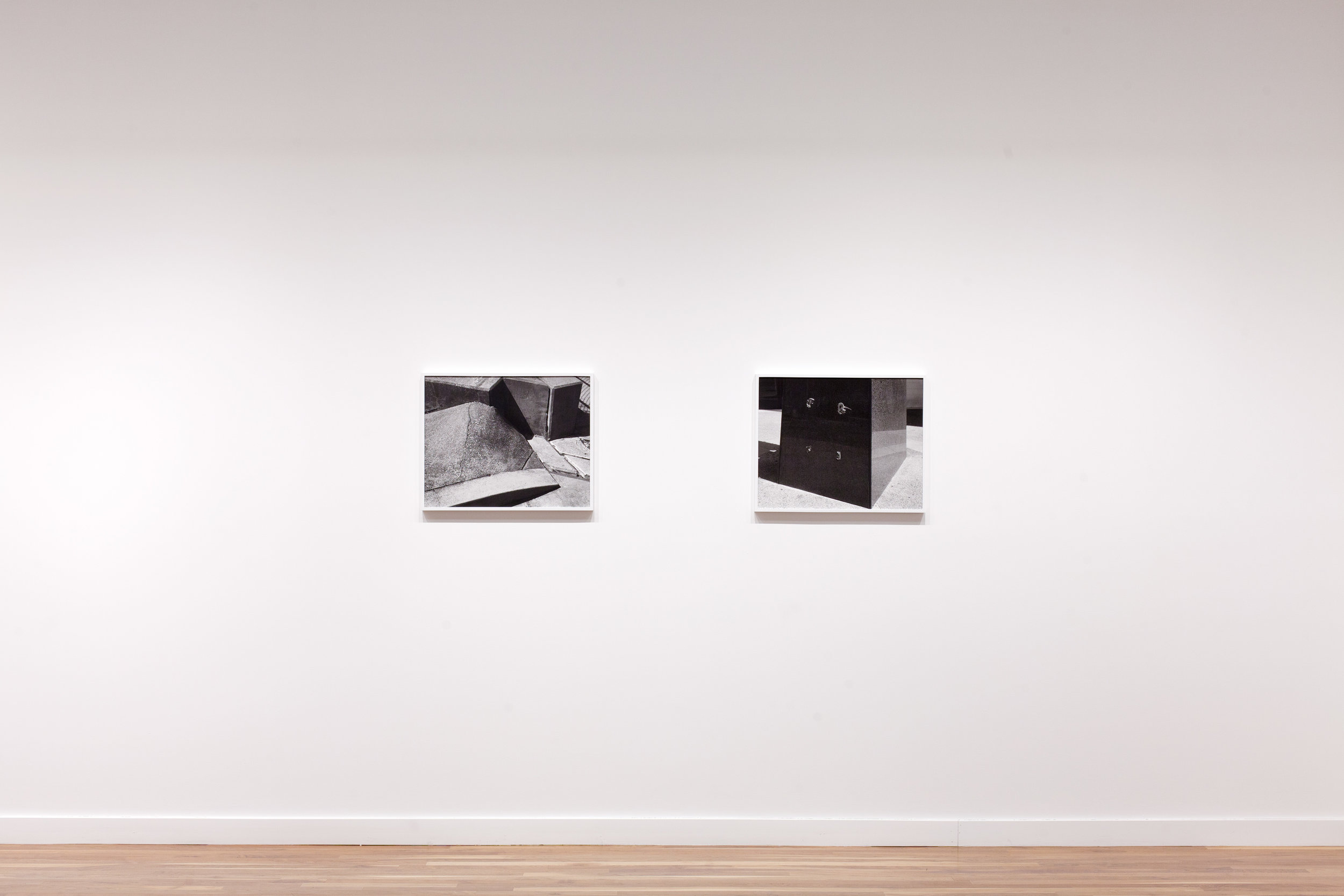 """Installation view. L to R:  """"Separation""""  and  """"Monument.""""  Both works 20x25, Archival pigment prints in painted wood frames, 2015."""