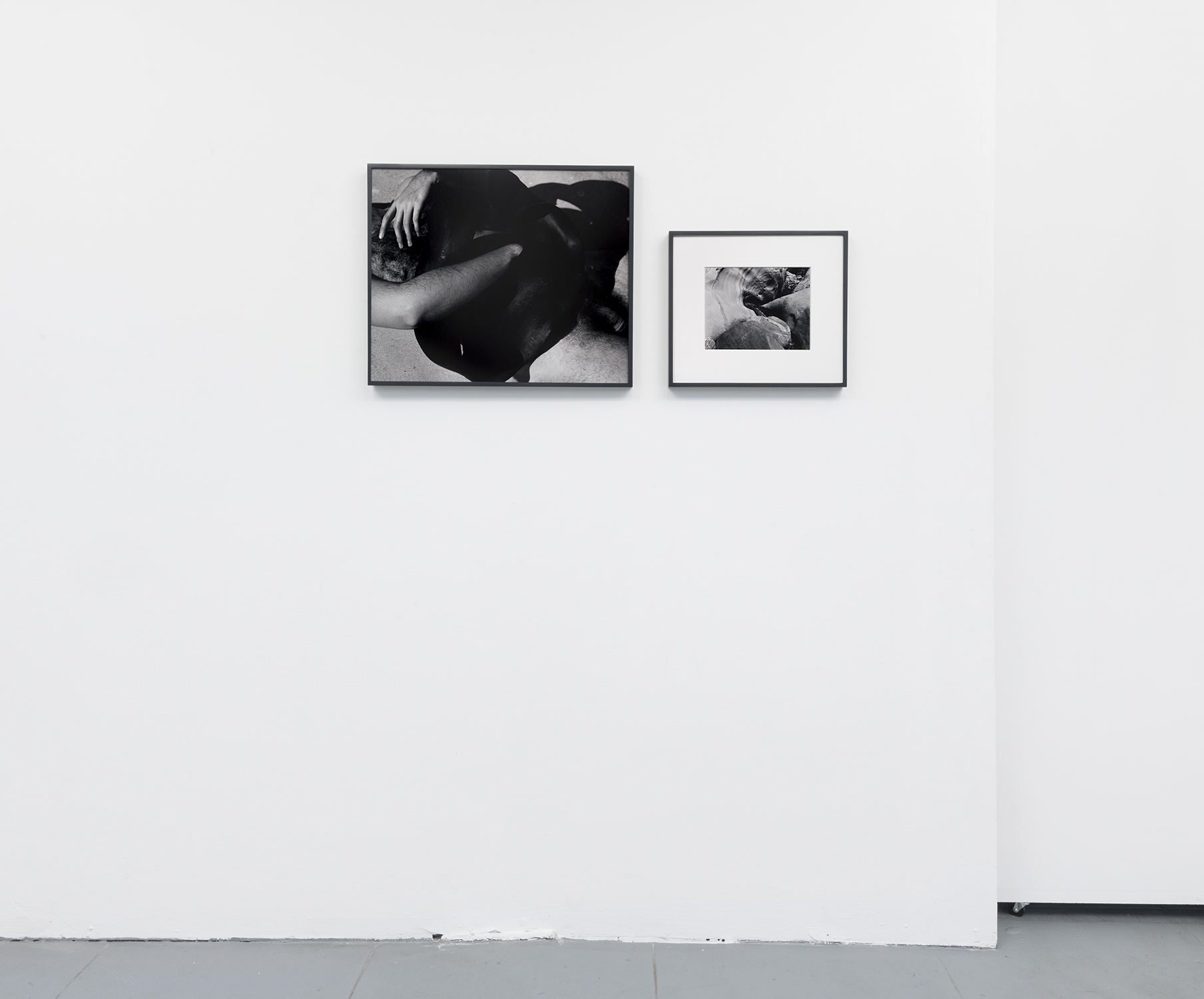 Installation view. L: Untitled, 19 x 23,selenium toned, silver gelatin print in painted wood frame, 2018.R: Untitled (Water Swirl),  8 x 10 inch selenium toned, silver gelatin print in 8 ply over-mat (13.5 x 15.5),painted wood frame, 2018