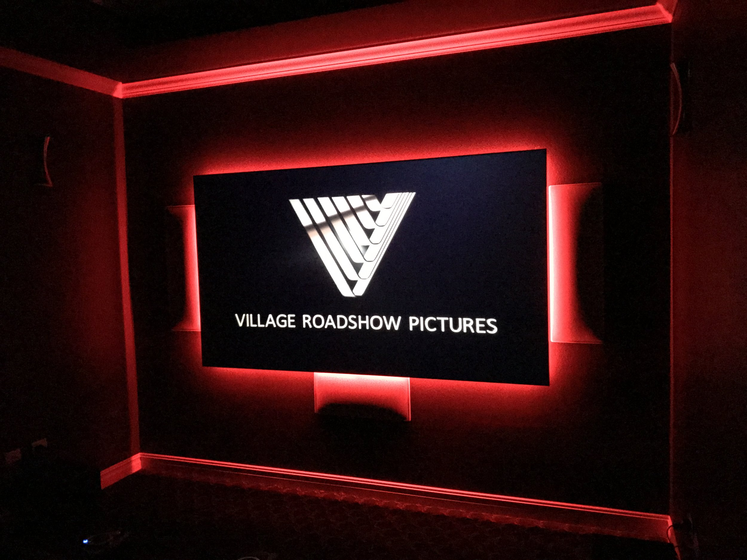 """120"""" ambient light rejecting screen, 4K projector, 7.2 surround sound, custom equipment rack and integrated control system."""