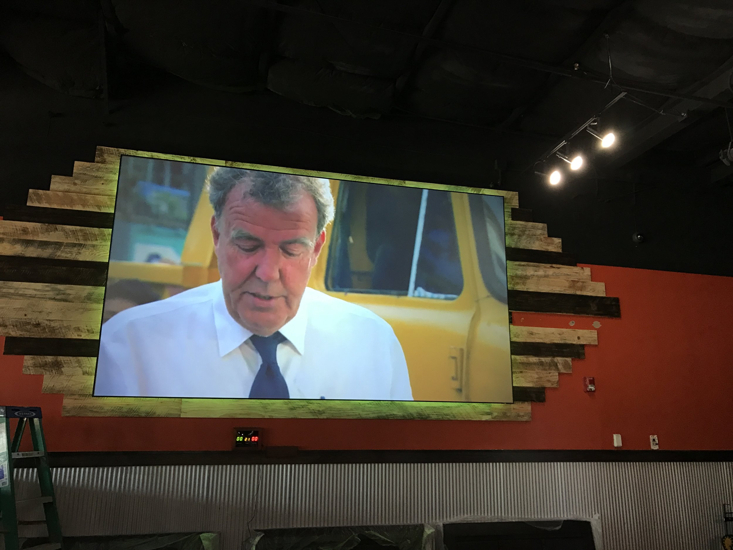 "Sports bar with 160"" ambient light rejecting screen with LED backlighting ."