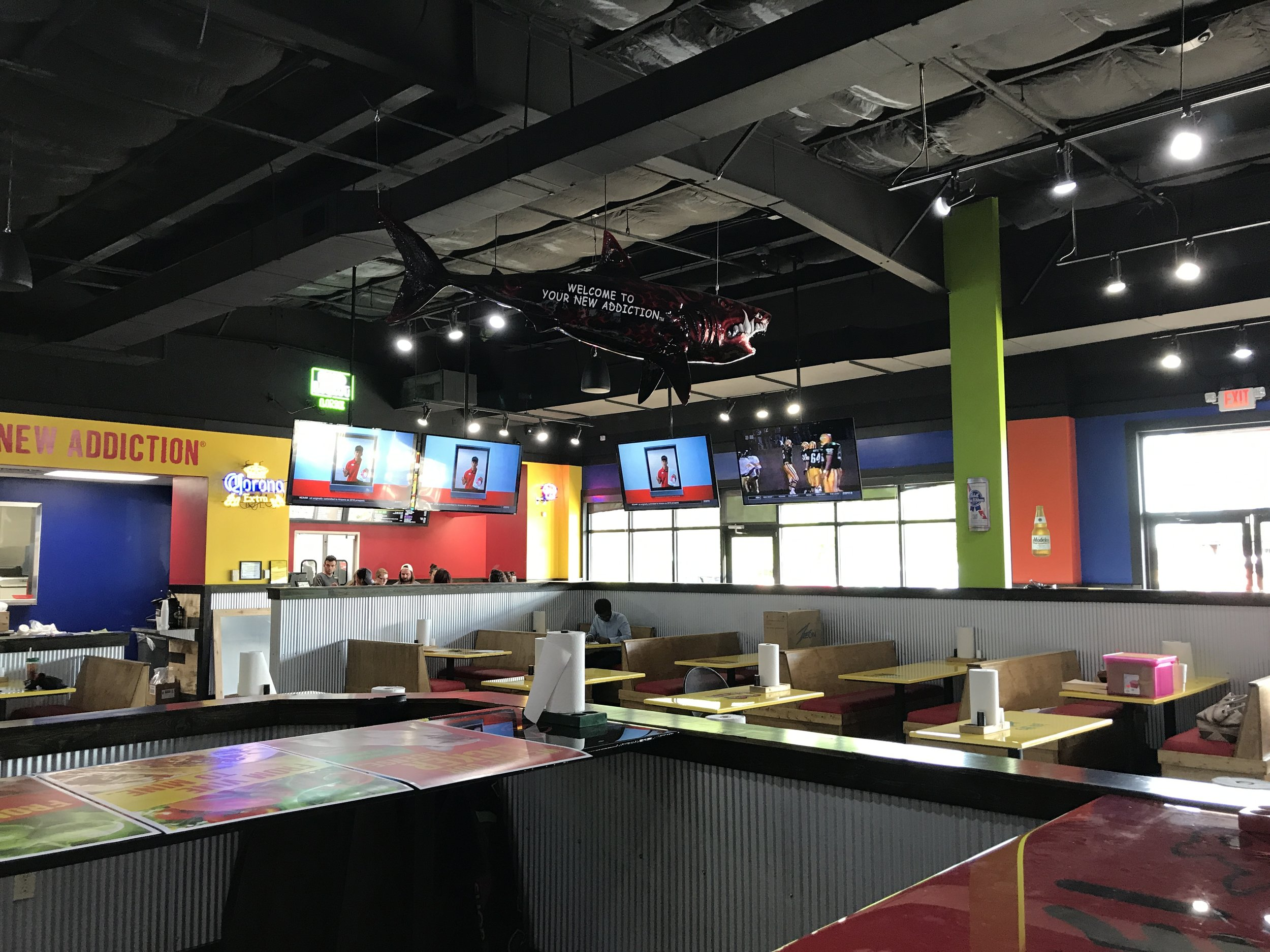 "Sports bar with (20) 65"" TV's, distributed pendant speaker system and integrated control system."