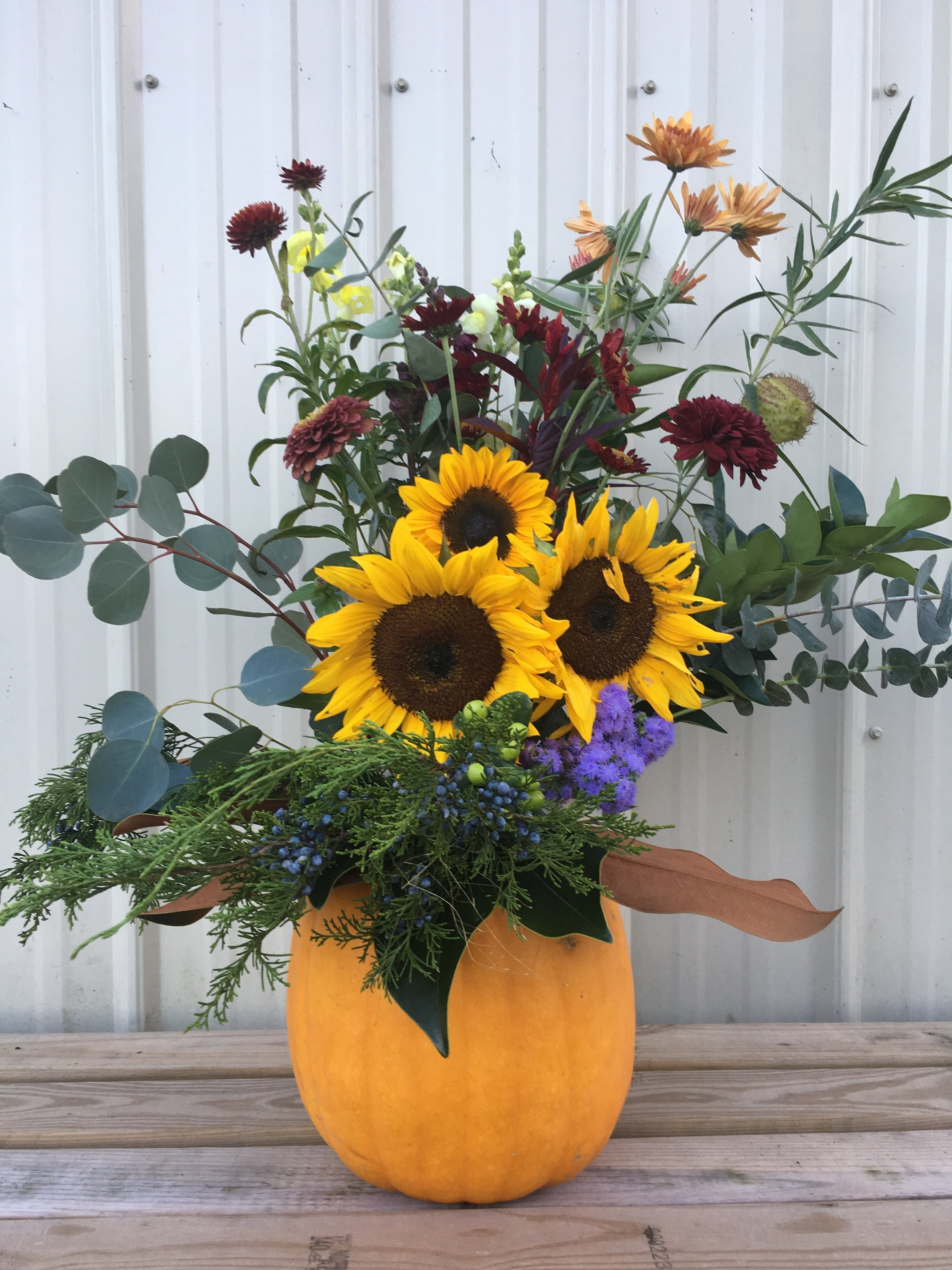 A pumpkin serves as the ultimate fall vase, right?