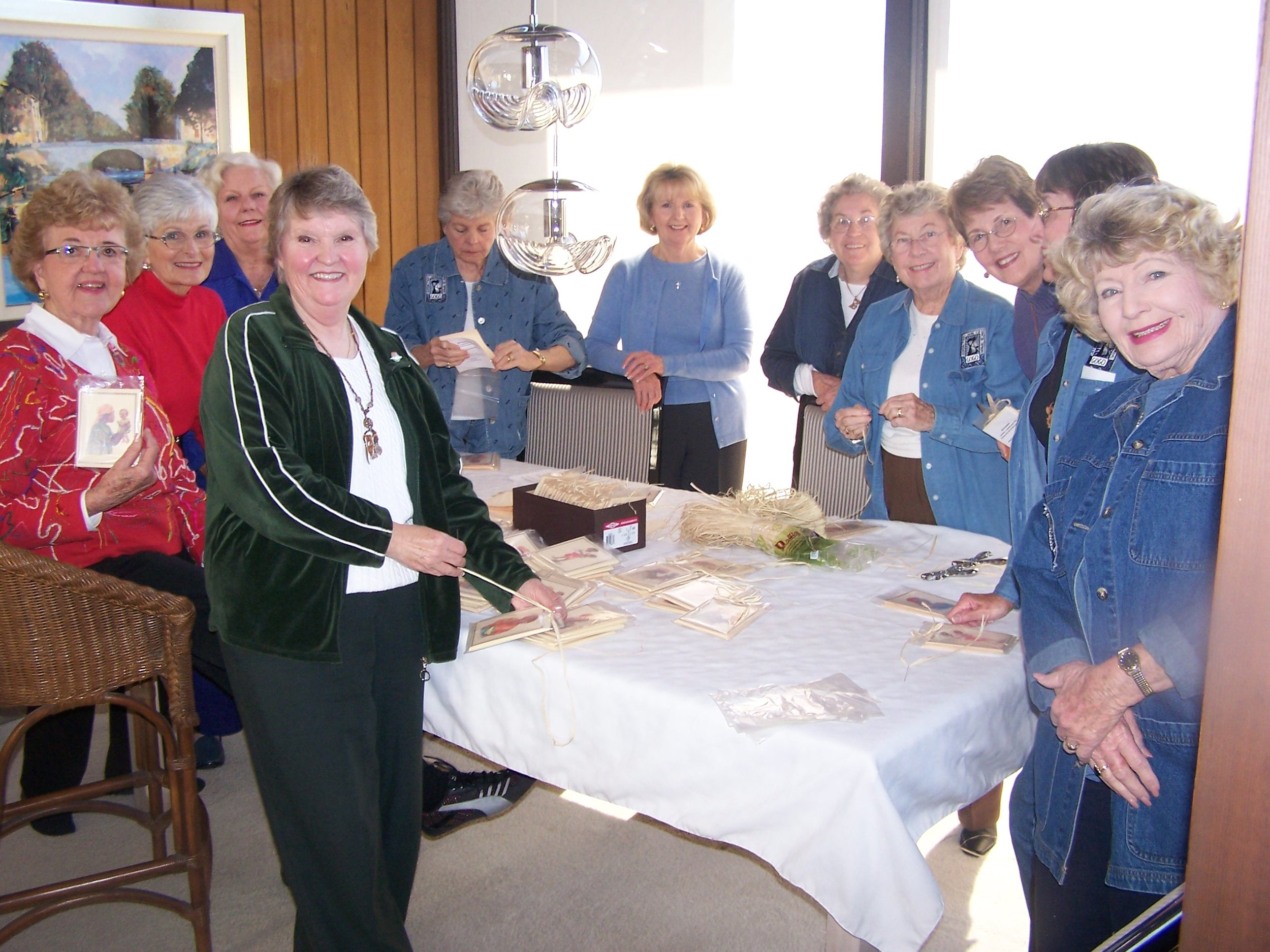 Mariners Church gogos (the original Gogo group) assemble note card packs for sale at a fund raiser.