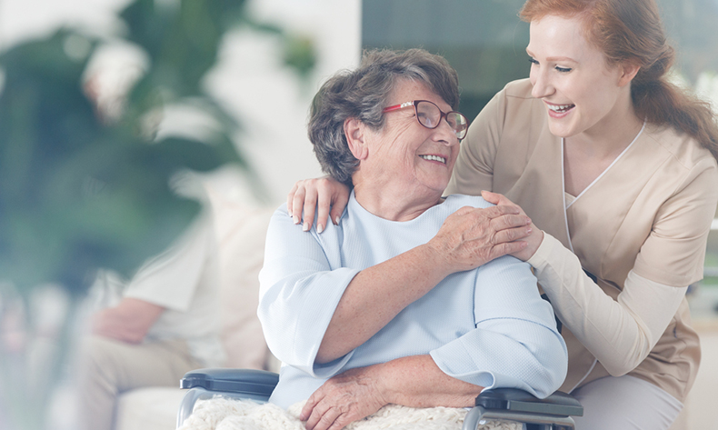 happy patient holding hand caregiver