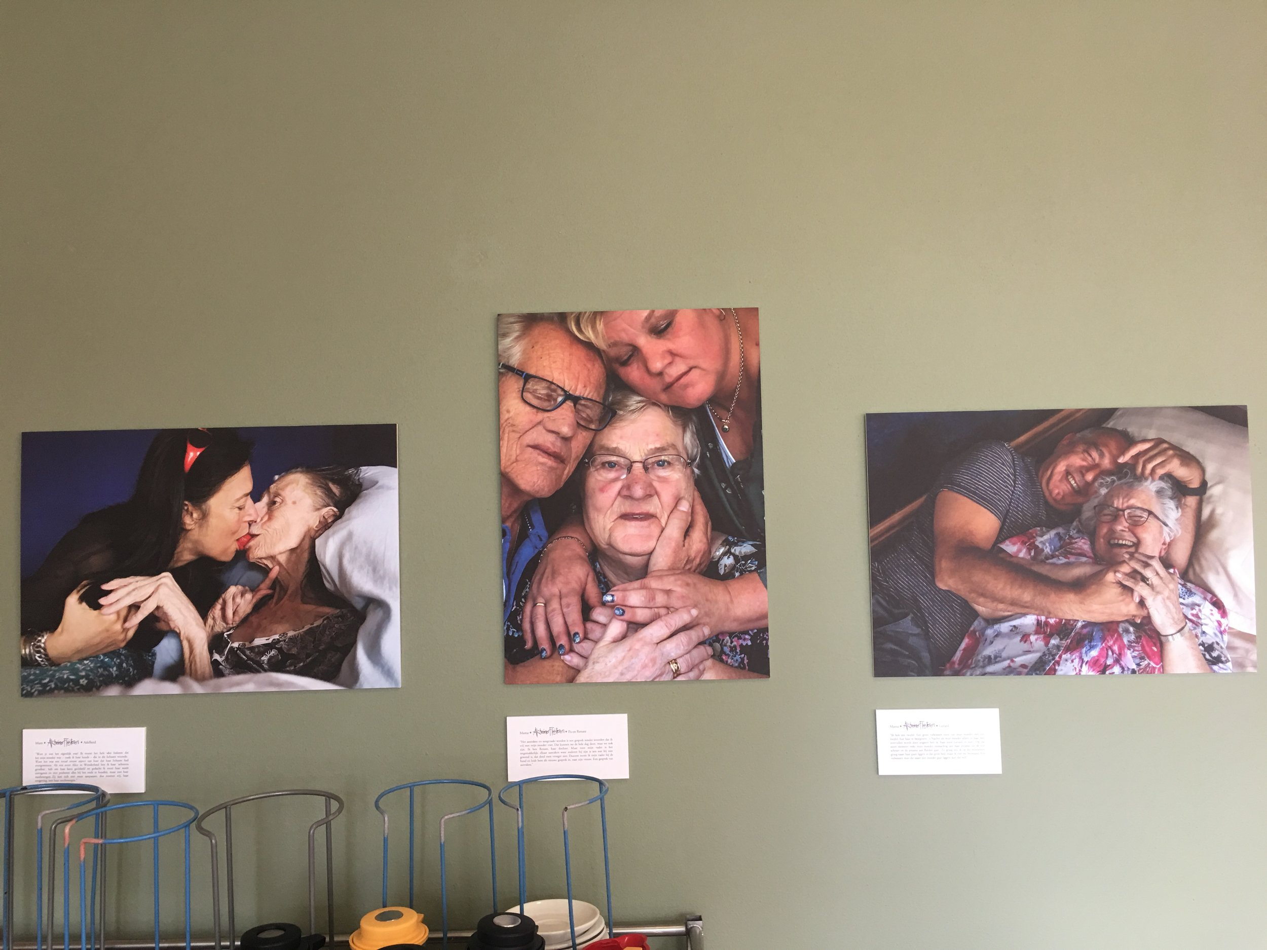 Pictures of residents with Alzheimer's hang on one of the executives of Humanitas' office wall. Gerard and his mother are in the picture on the right.
