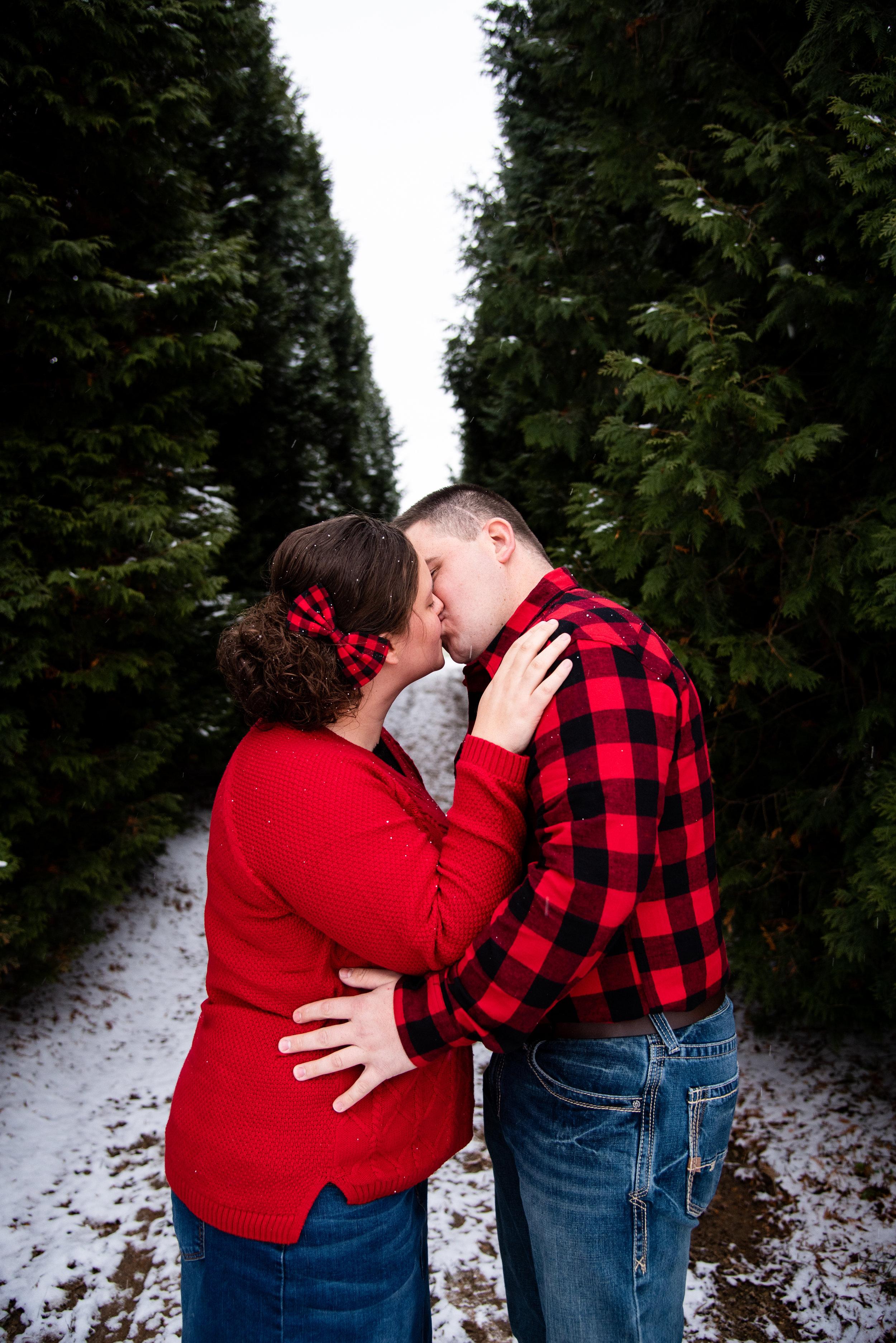 Kyla Jo Photography // Muncie, Indiana // Couple Photographer // Whitetail Tree Farm // Christmas Photos // Midwest Photographer // Indianapolis Photographer // Kissing Couple