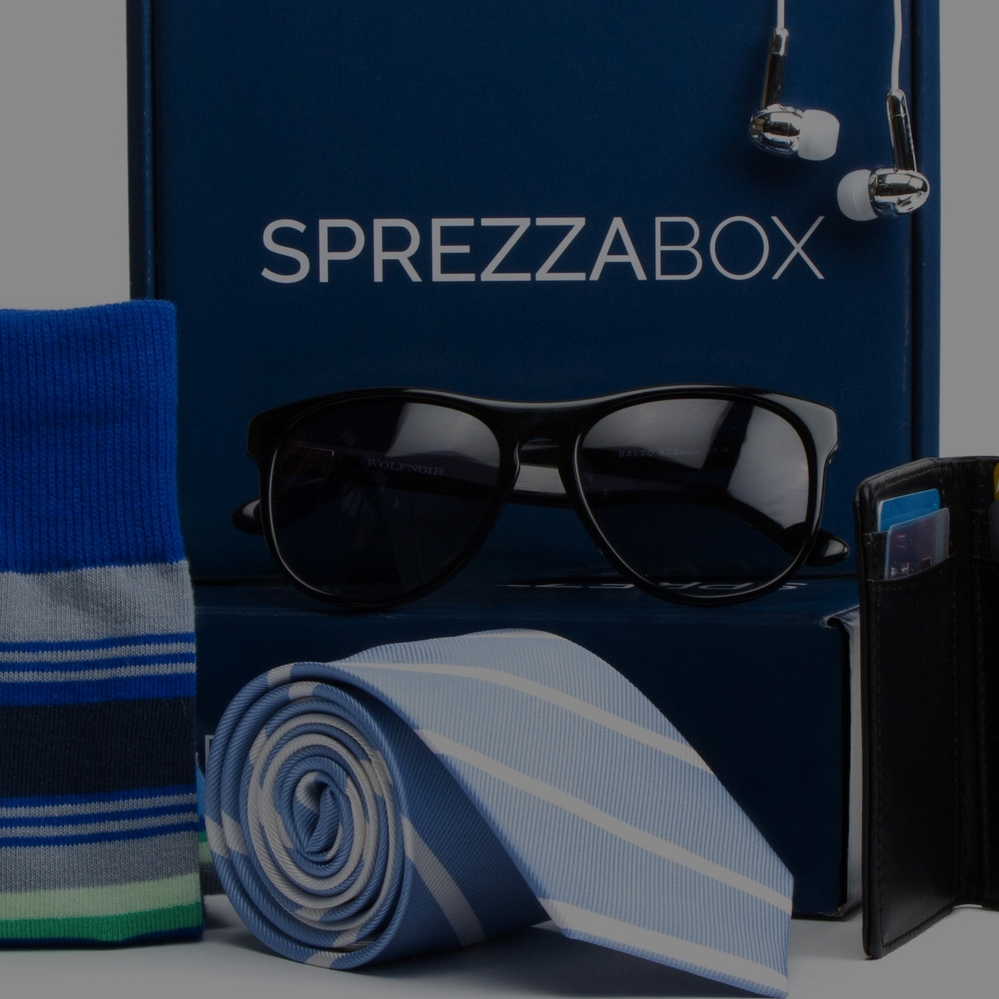 SprezzaBox - An accessories box with items like ties, pocket squares, socks, and more.