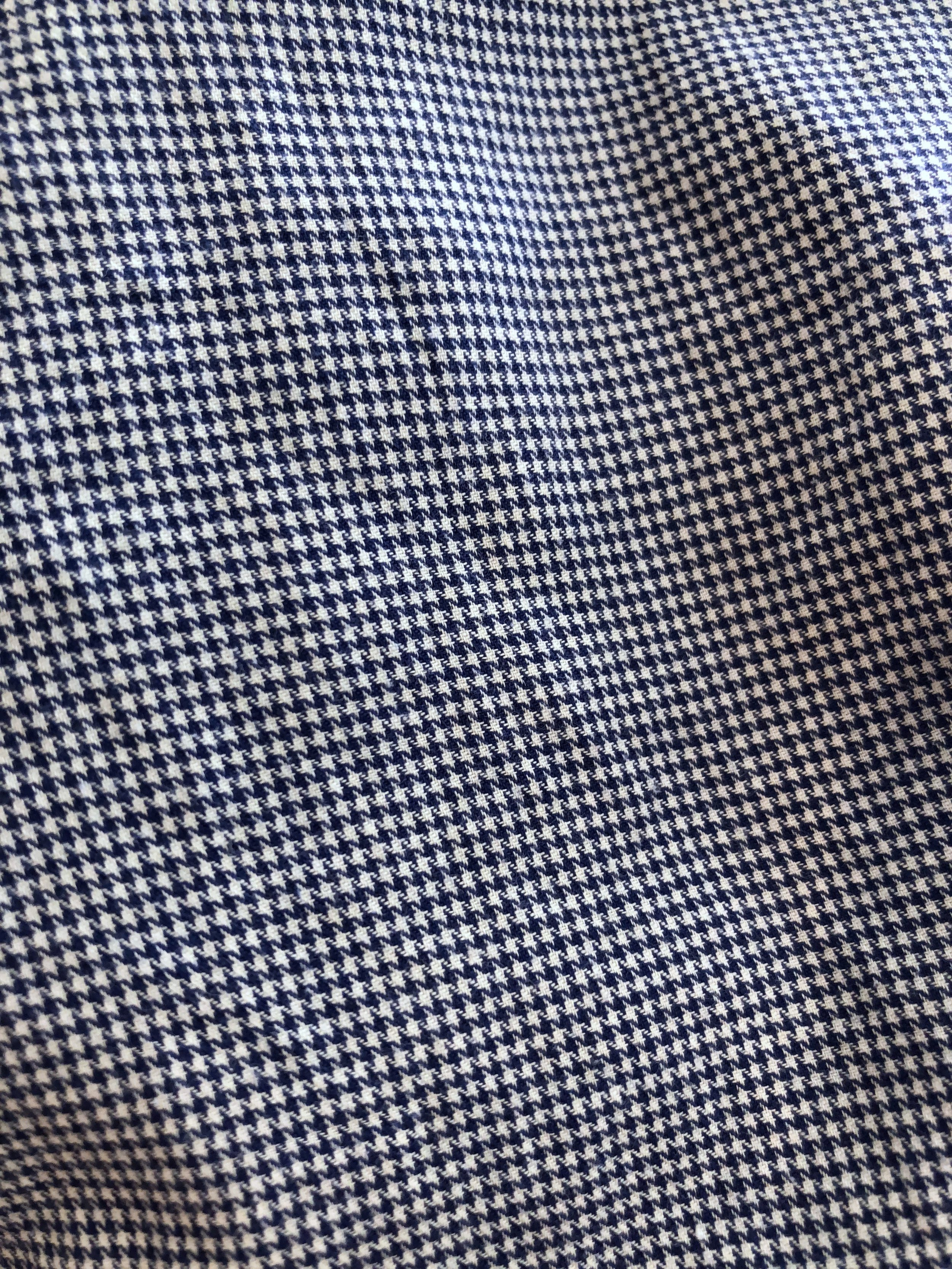 Close-up of the navy houndstooth cashmere blend fabric