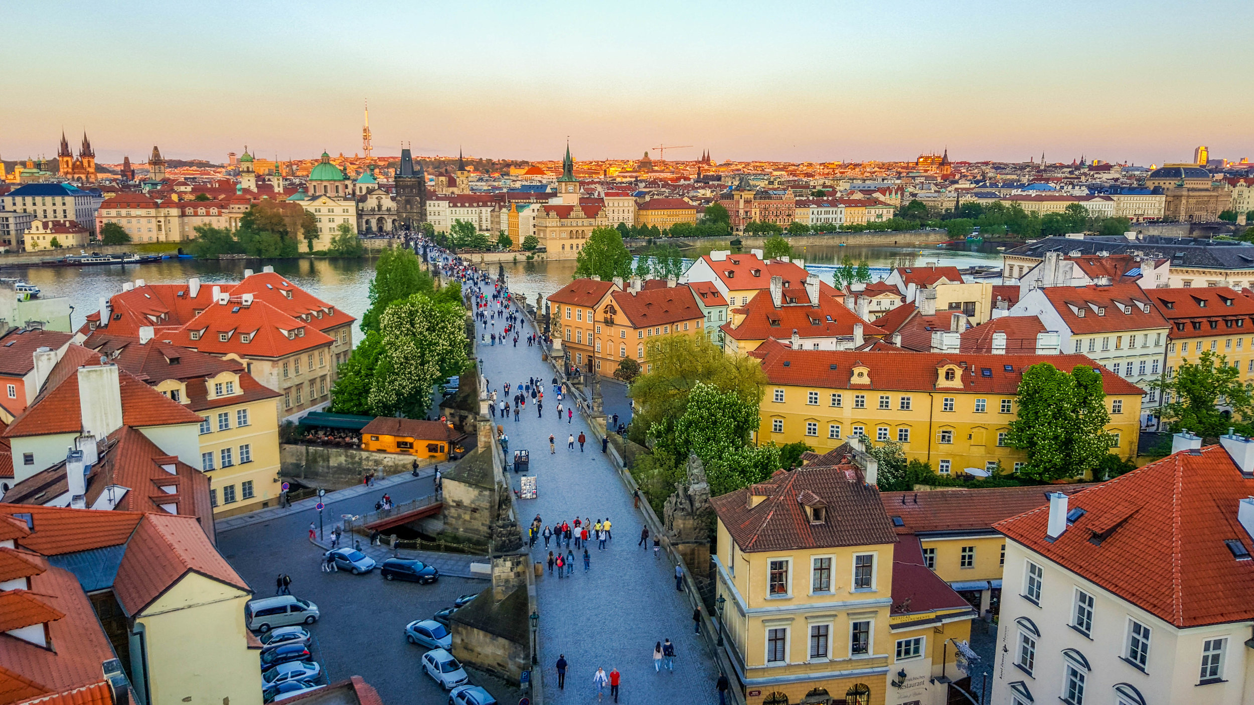 View of Charles Bridge from the Lesser Town Bridge Tower at dusk.