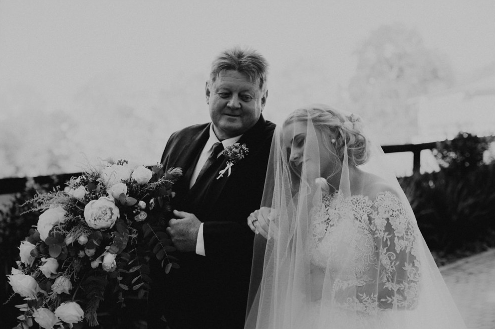 Some of my favourite fittings were with this bride's family where, as a group of women, they stood strong and supported Caylee. They laughed together, cried together and like warrior women they not only took care of the bride but took care of one another.  Photo Michigan Behn