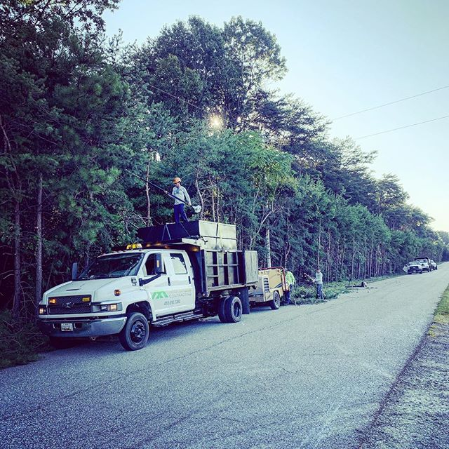 Trimming county roads. Give us a honk and wave if you drive by. MD Licensed Tree Expert # 2149 - Licensed & Insured