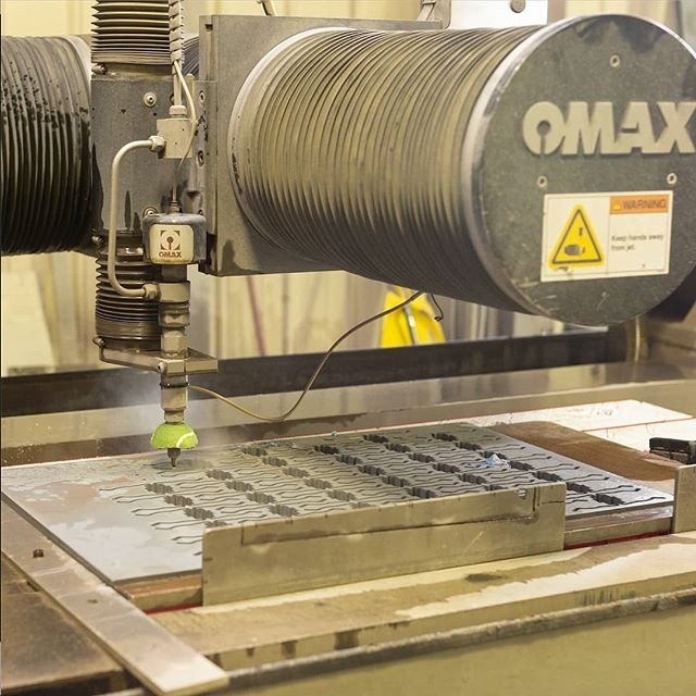 Our abrasive waterjet machine cuts with precision and can be used on virtually any material. #omax #waterjet #precise