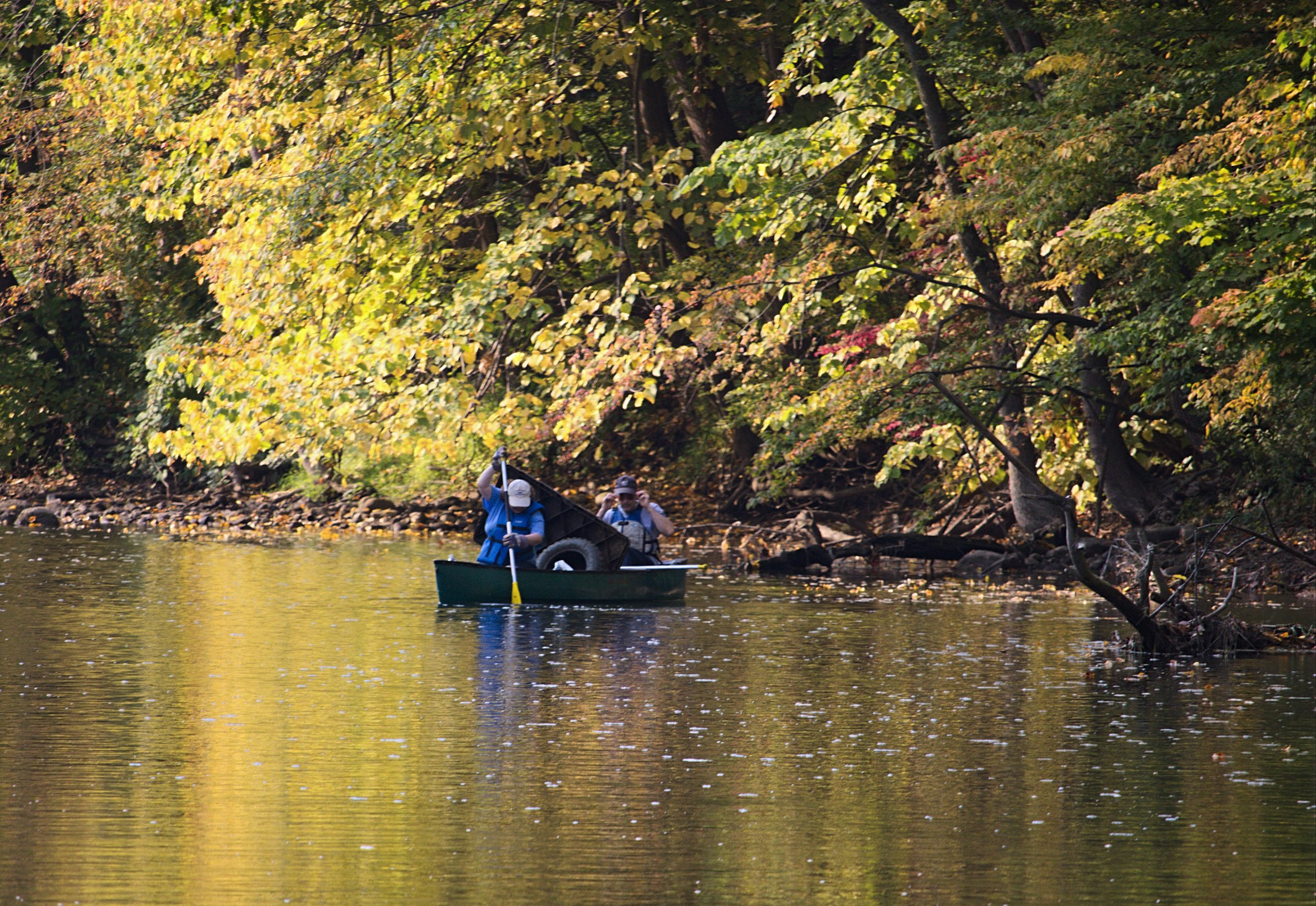 Werdon and Sonday were barely a half-mile down the river when their canoe was weighted down with a tire, an old plastic patio table, and several bags of other garbage.