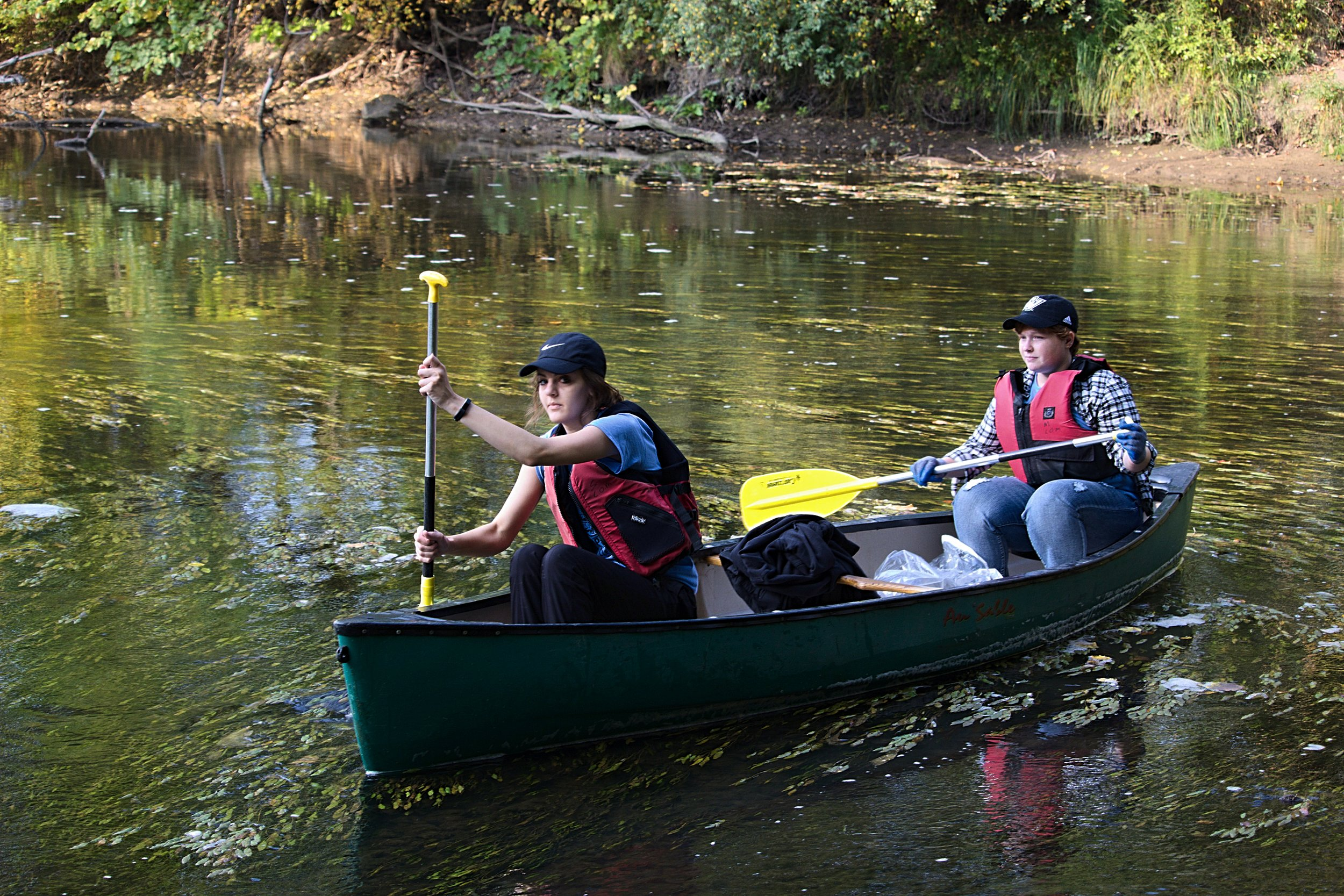 Sydney Kamaloski(right) and Alainna O'Neill led the group. Because of the low level of the river, the canoes would run aground on the rocky bottom of the river frequently. You can see Kamaloski planting the paddle in the river bottom to drag the canoe along.