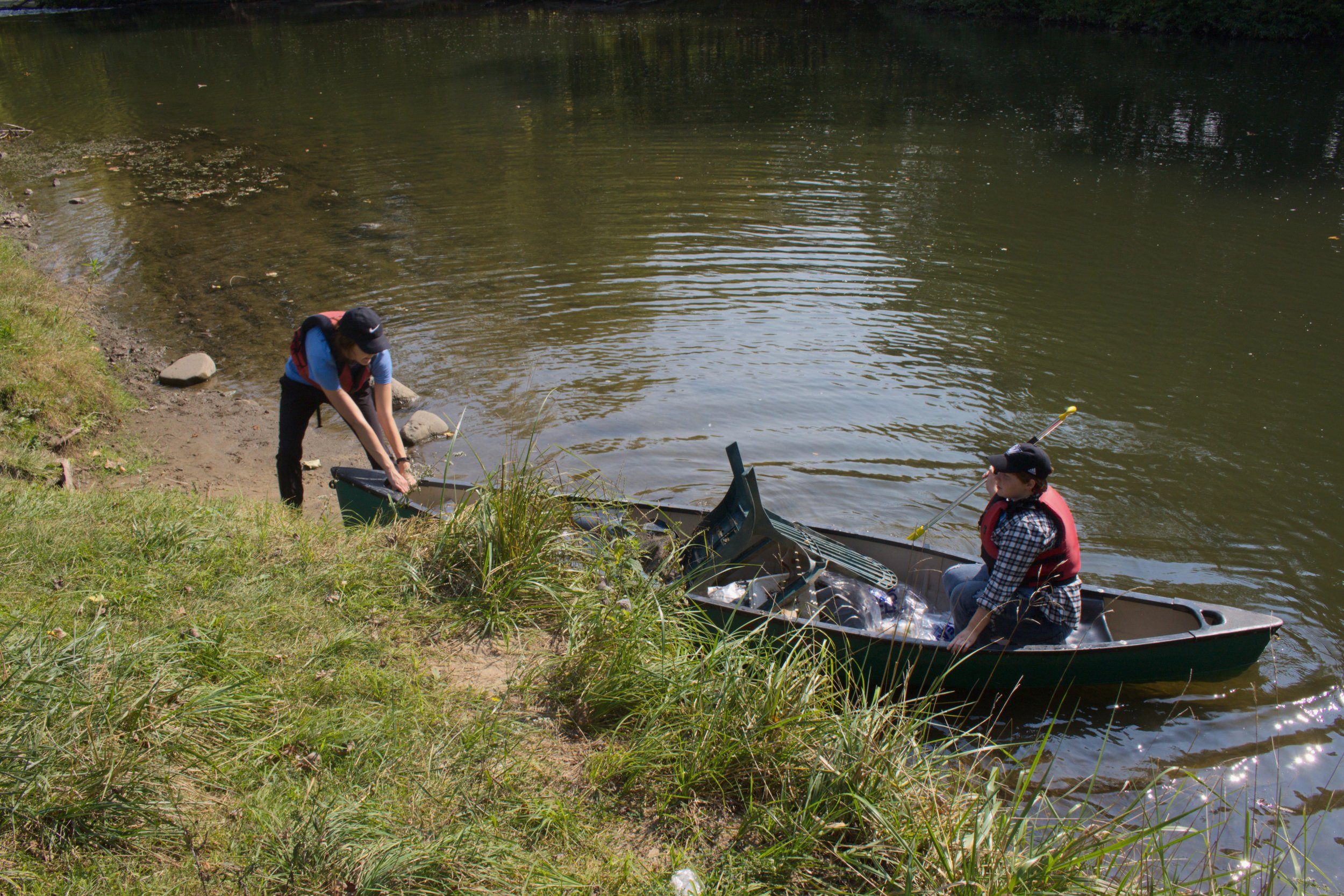 By the time Kamaloski and O'Neill reached Ruehs park again, they had collected several bags of garbage and a plastic Adirondack chair. Once the garbage was removed, the volunteers rinsed out each canoe, which were on loan from Camp O'Malley.