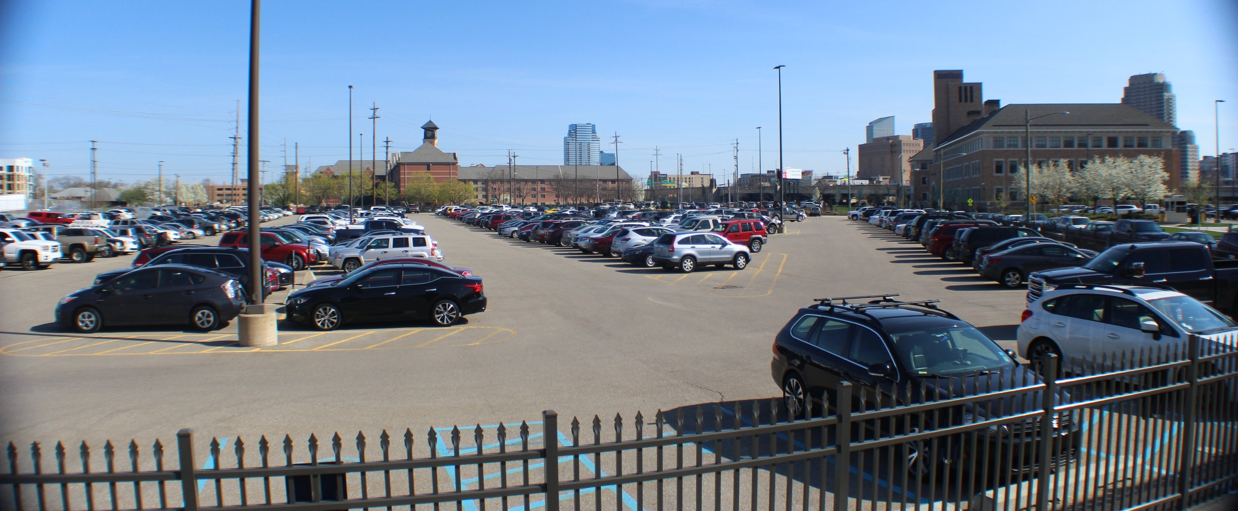 One of the large surface lots south of Fulton Street in use by Grand Valley State University.