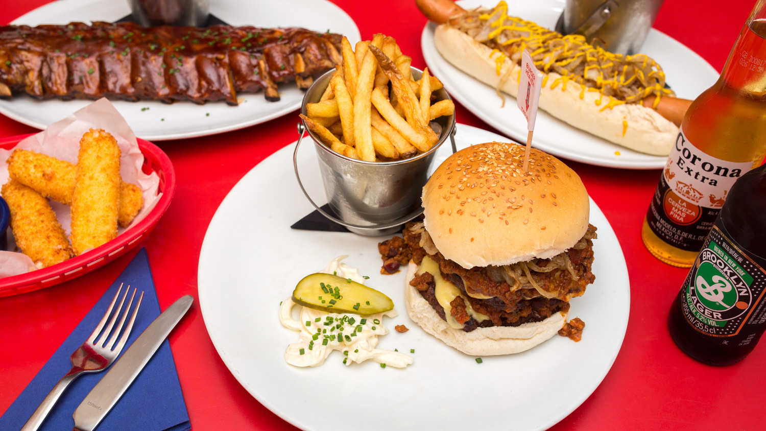 American diner food on a red table