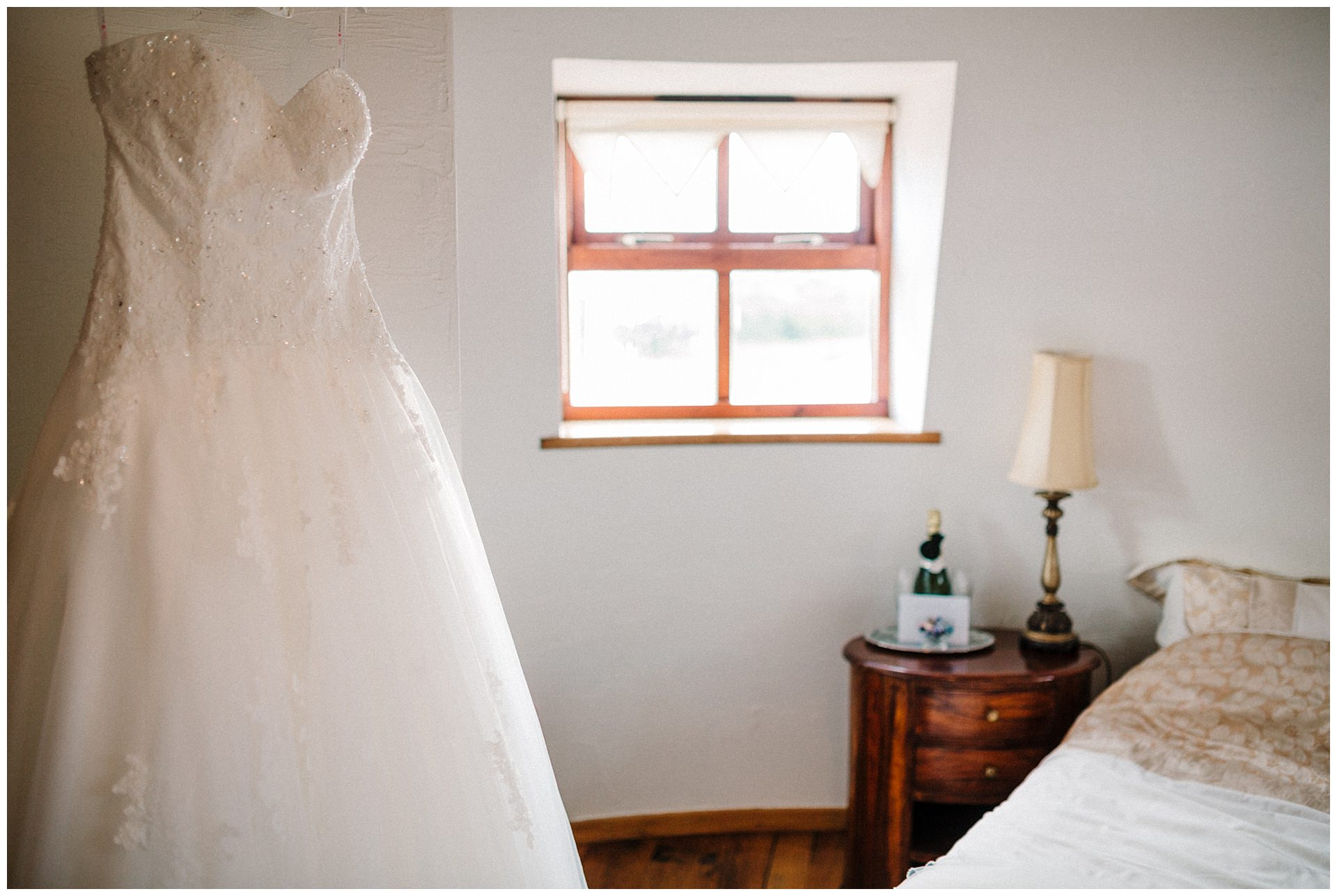 A wedding dress hanging in a wedding suite at fishlake mill