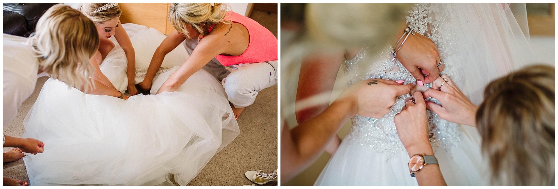 bride putting on her wedding dress at a yorkshire wedding.jpg