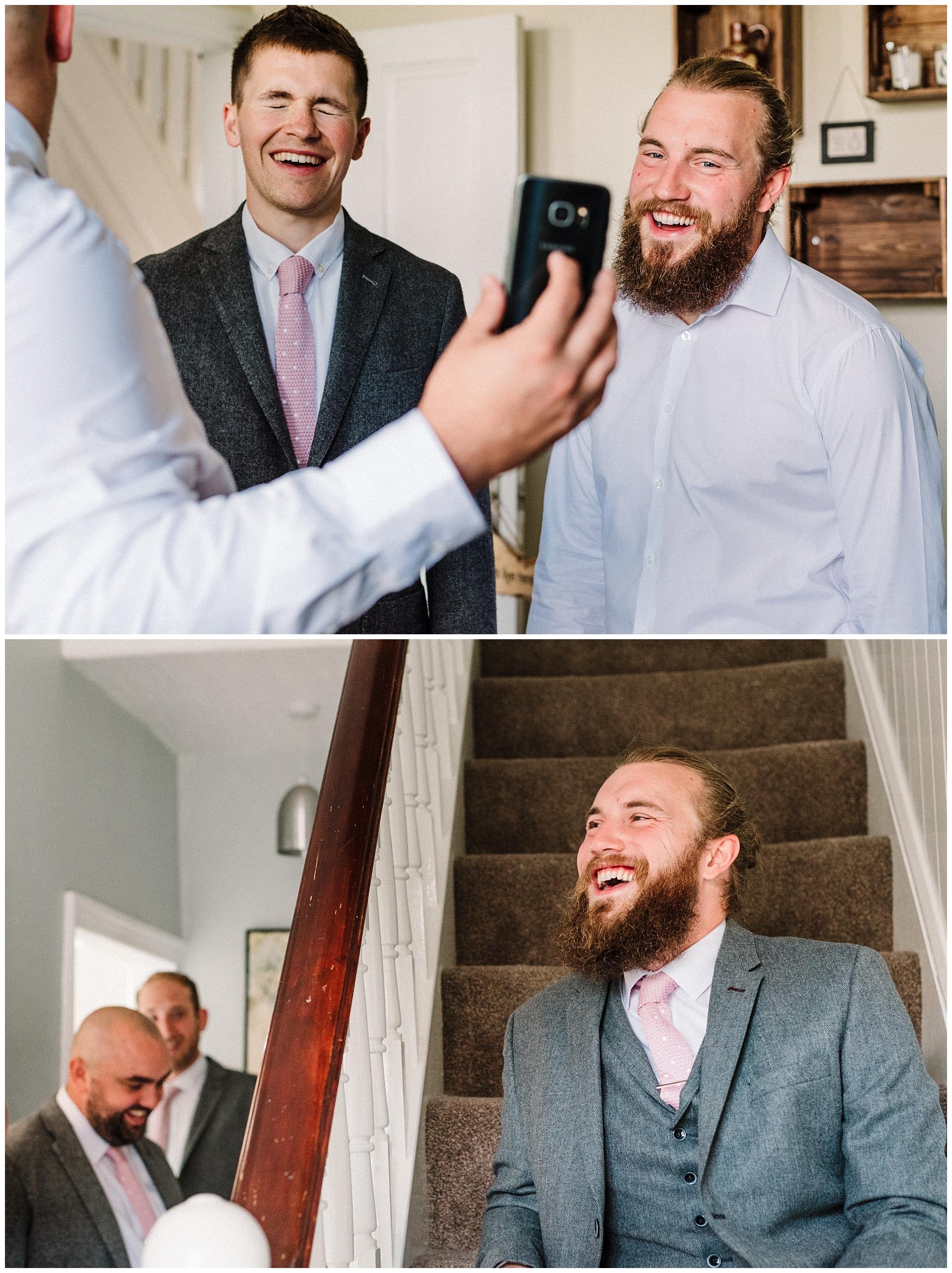Groomsmen laughing before a wedding.jpg