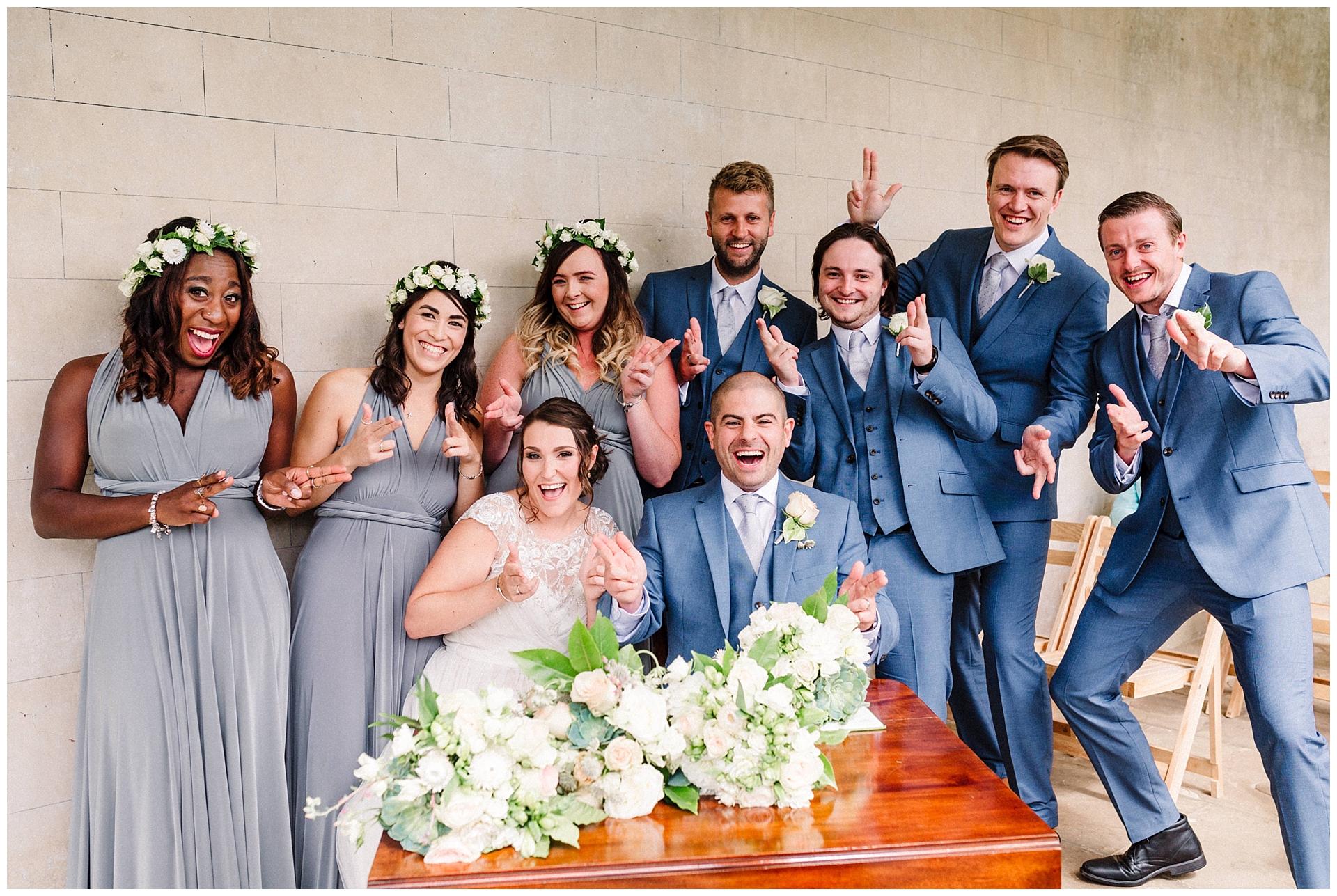 bridesmaids and best men doing finger guns