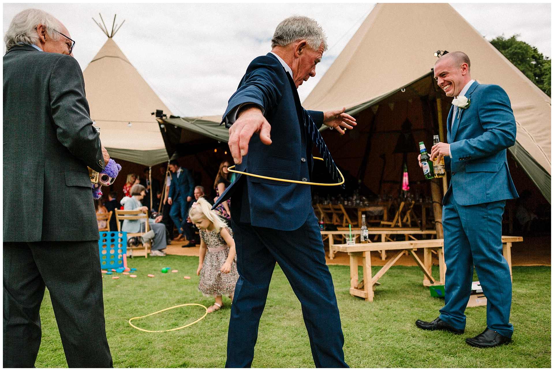a wedding guest hula hooping at a tipi wedding in yorkshire