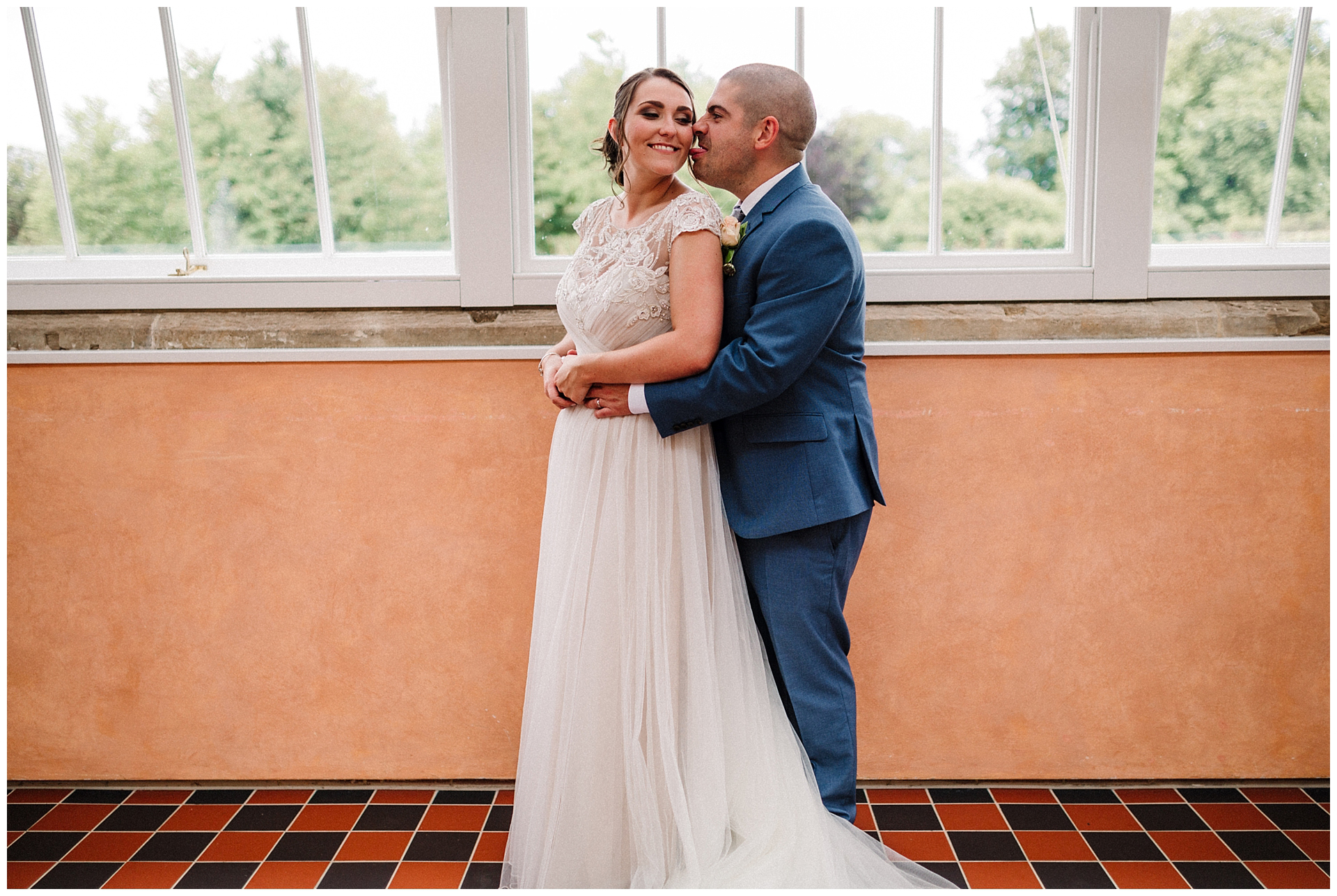 a bride and groom in the walled garden at scampston hall
