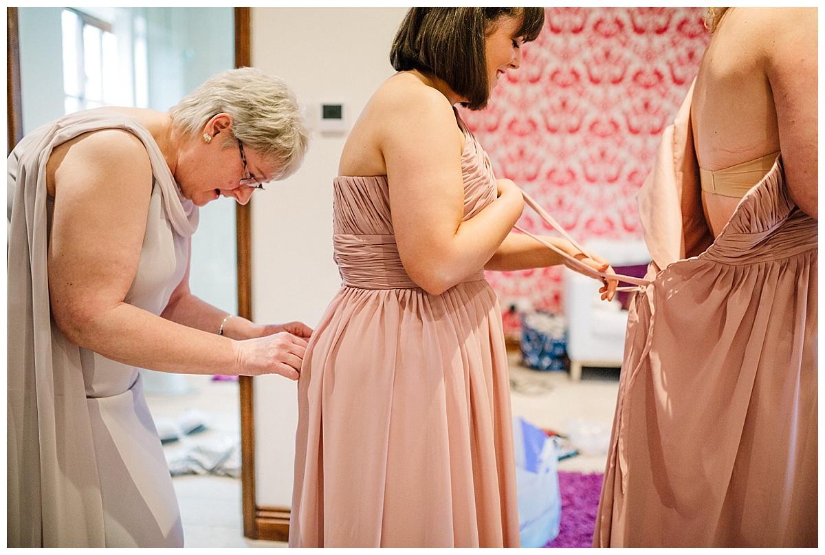 bridal party getting ready at a barn wedding