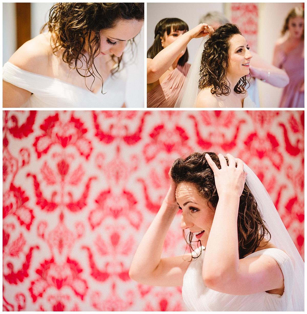 a bride getting ready at a barn wedding