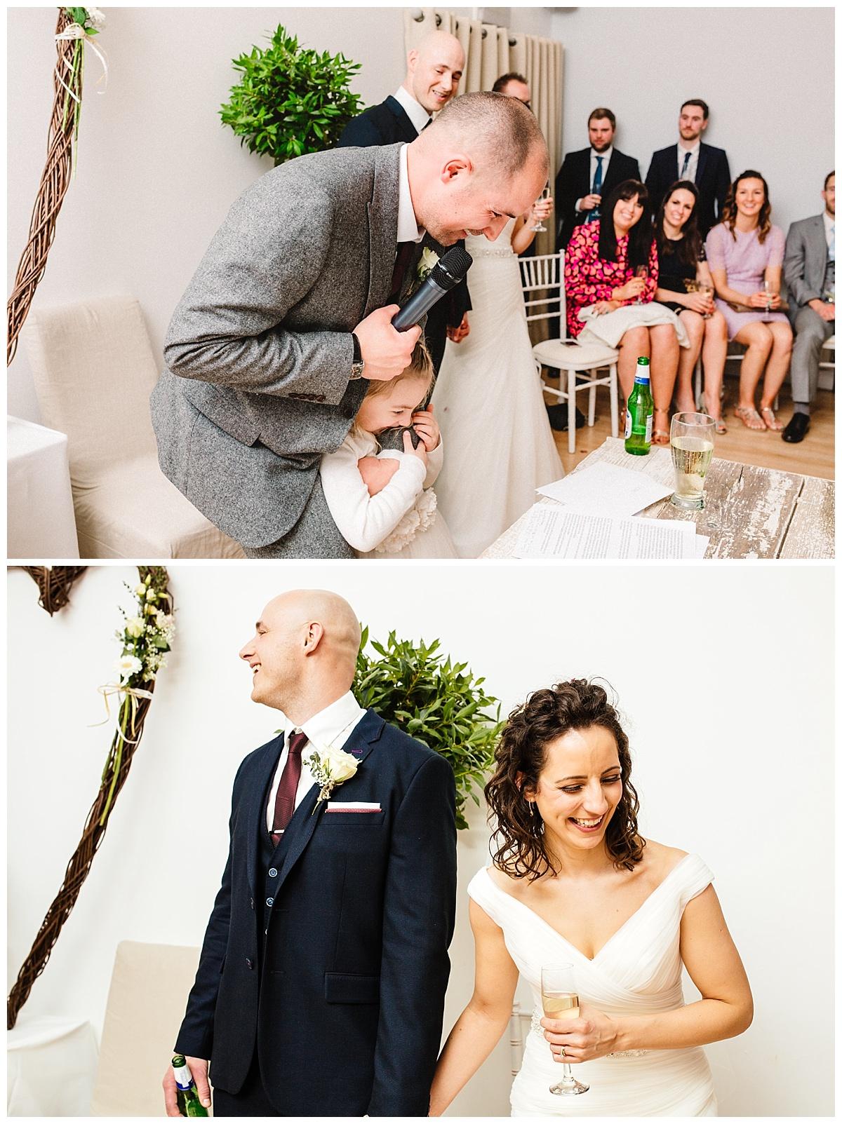 documentary photography of wedding speeches at a barn wedding