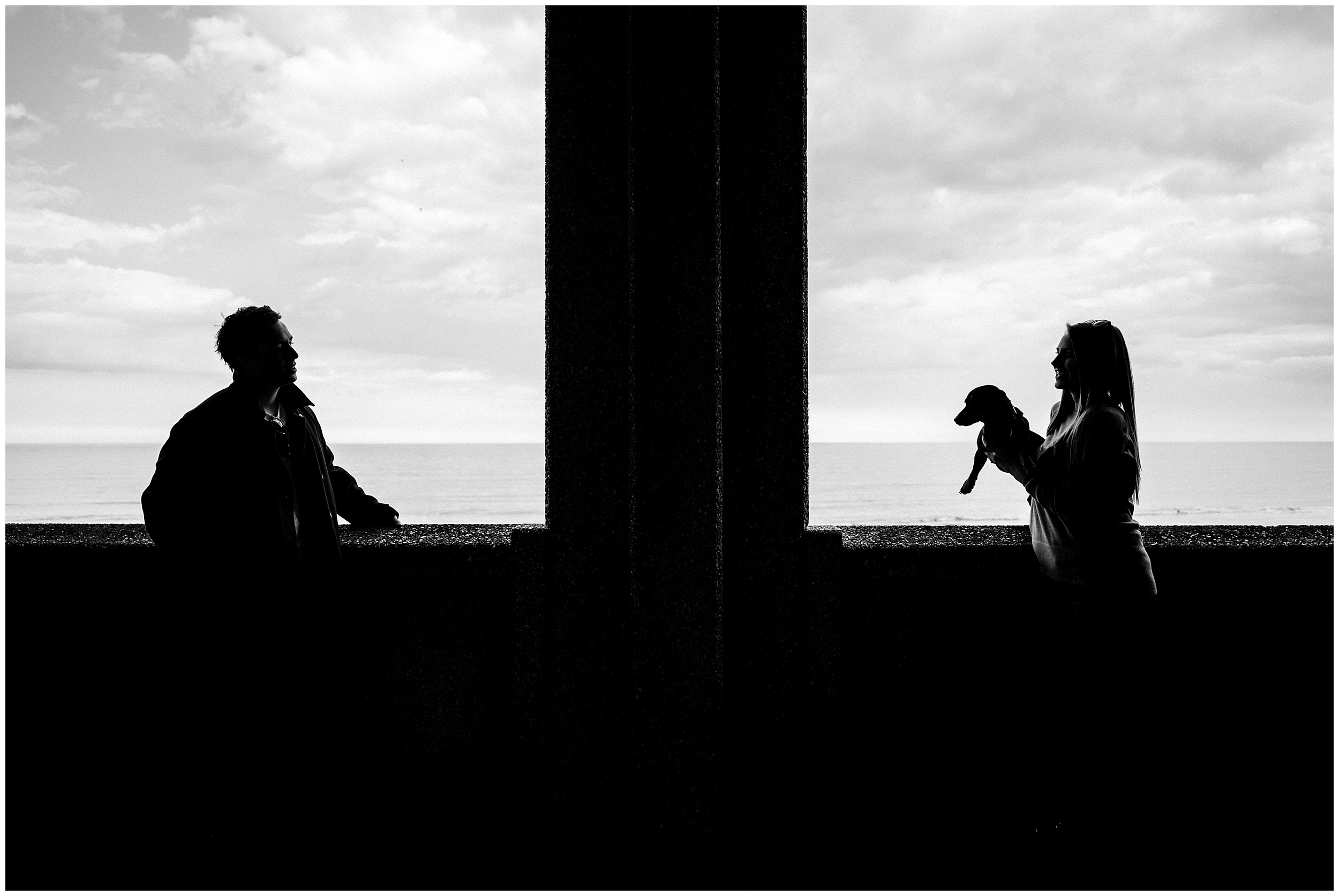 A silhouette of a couple and their dog in Scarborough