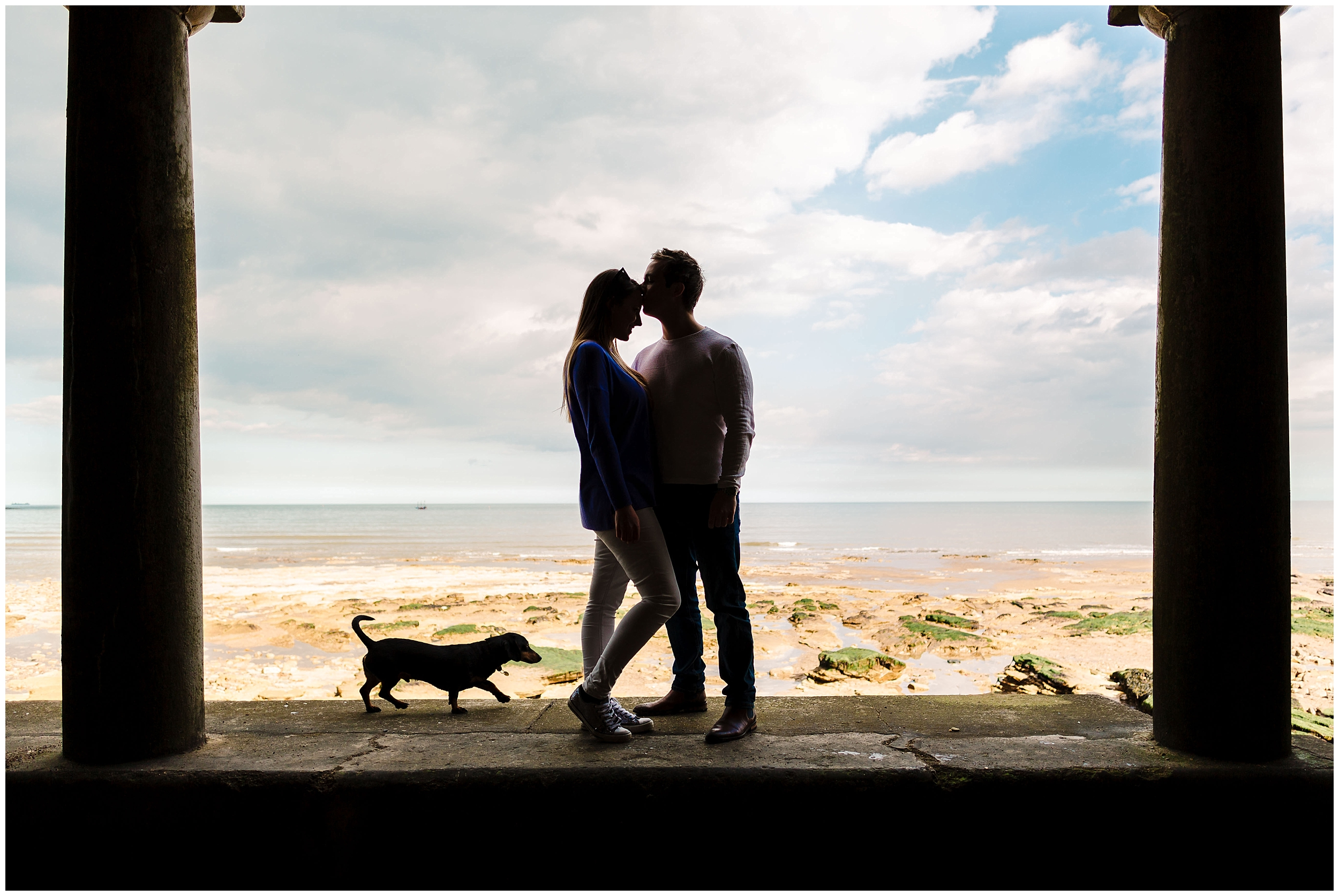 A couple on south bay beach in Scarborough, Yorkshire