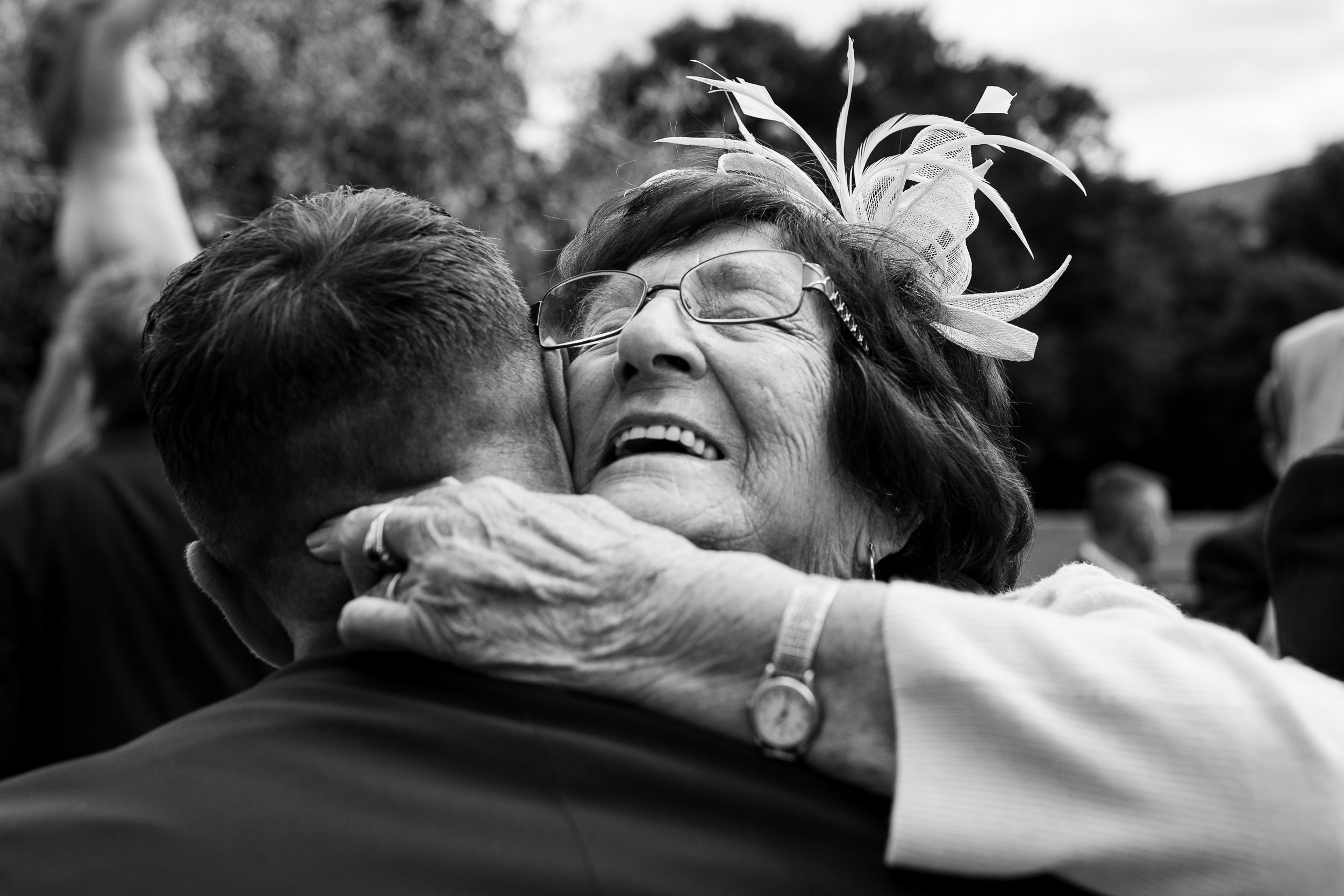 A groom and his grandma hugging after a wedding ceremony in Yorkshire