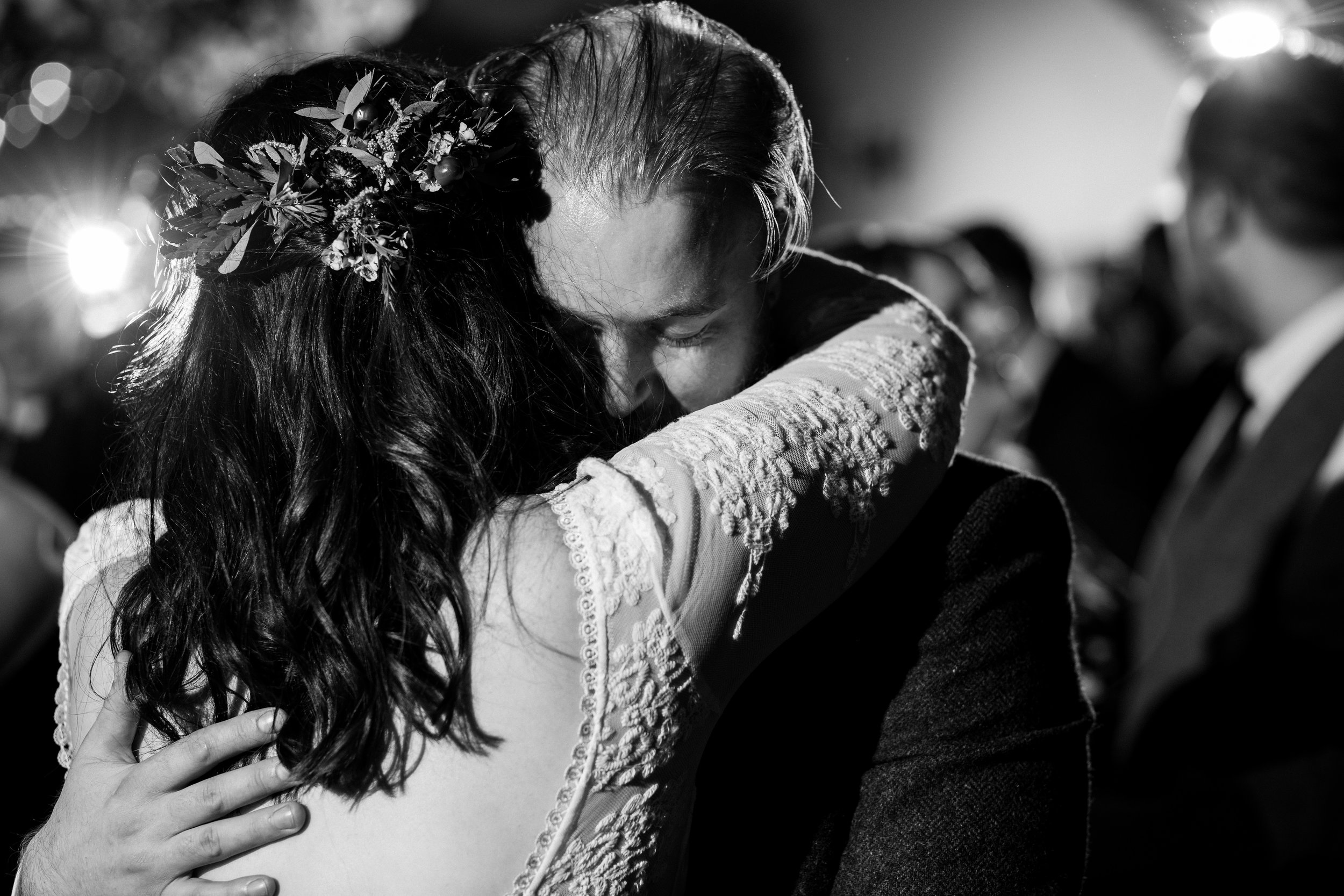 A black and white image of a bride and groom slow dancing