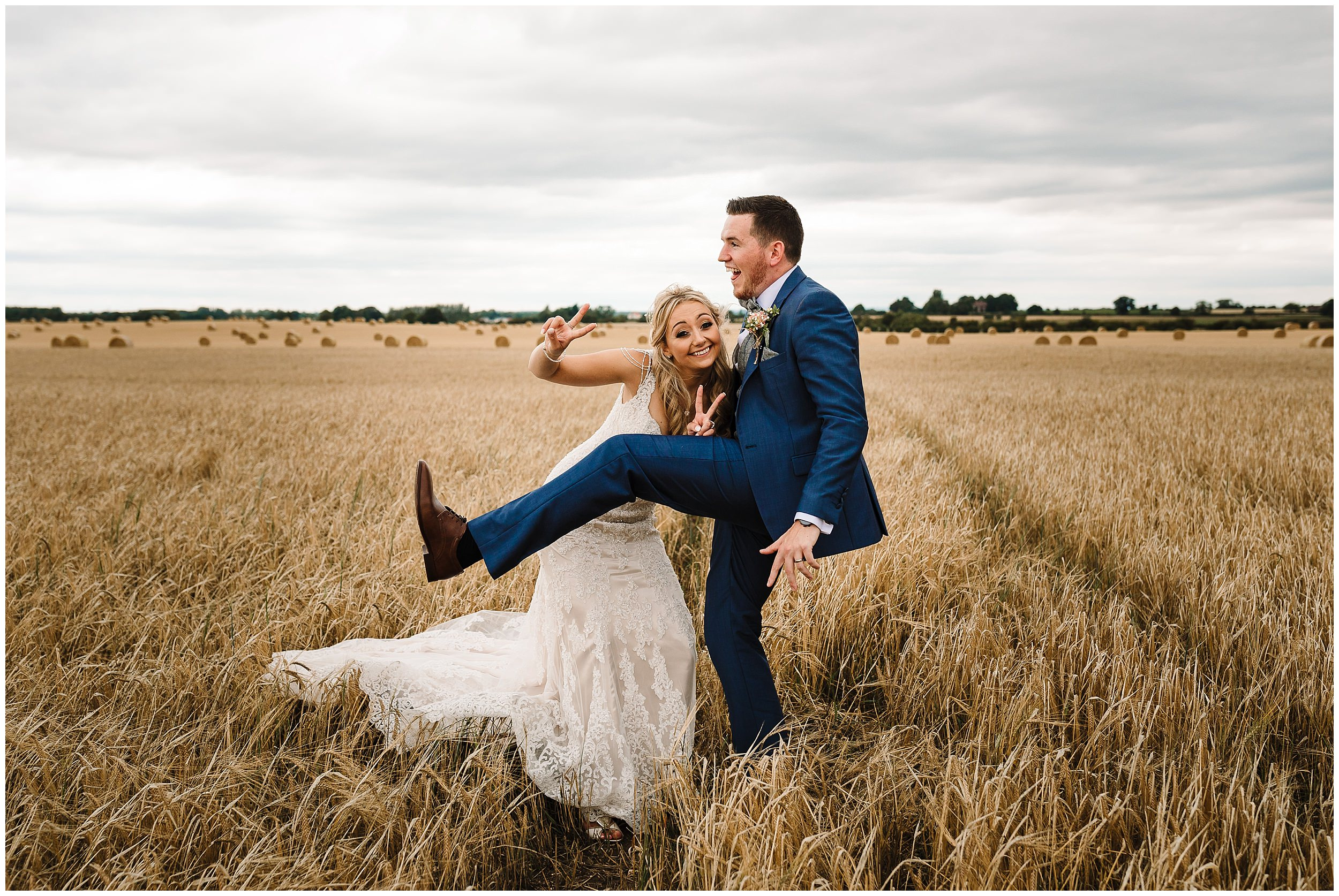A BRIDE AND GROOM BEING SILLY IN A FIELD IN YORKSHIRE