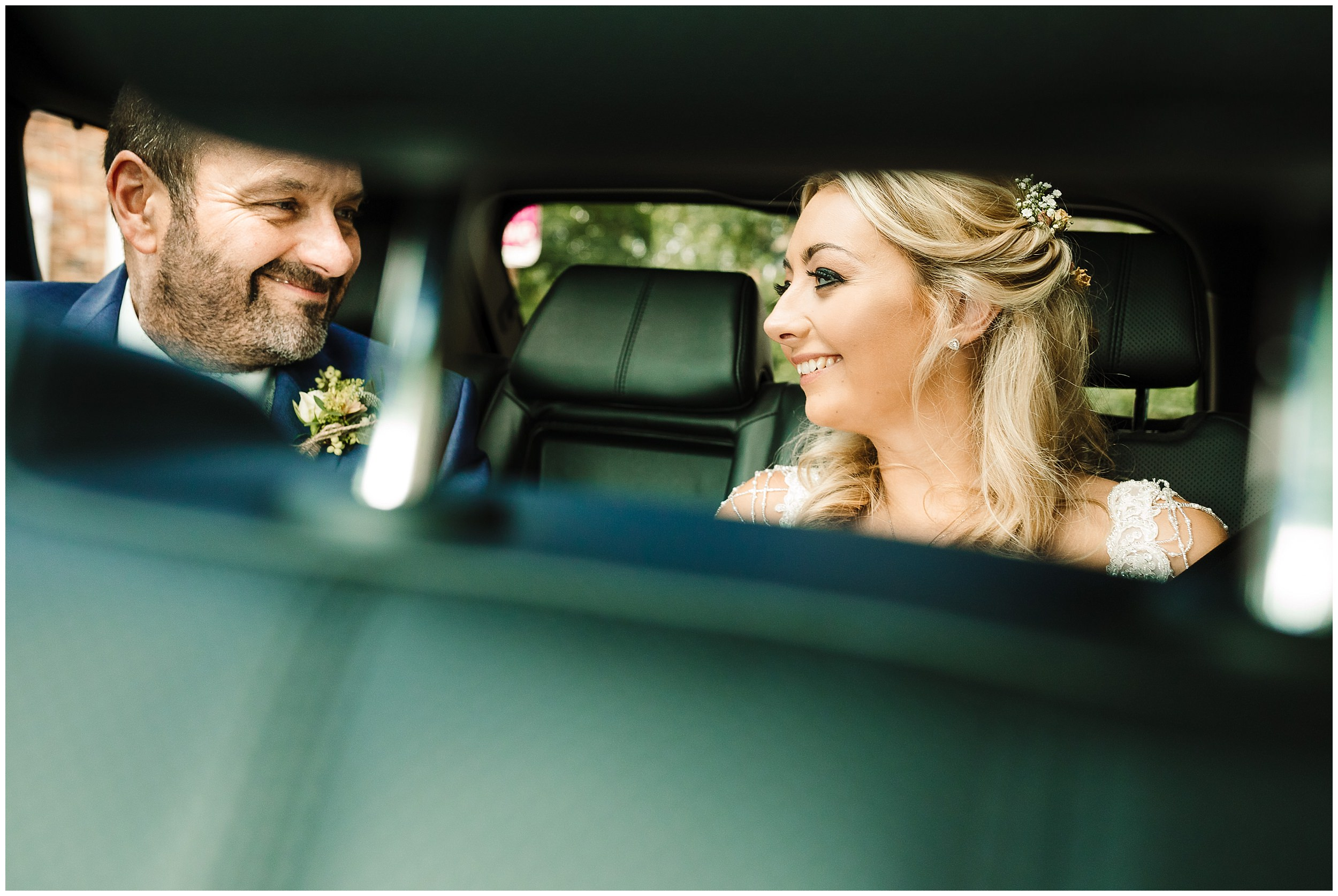 A BRIDE AND HER DAD IN THE CAR ON THE WAY TO HER WEDDING IN YORKSHIRE