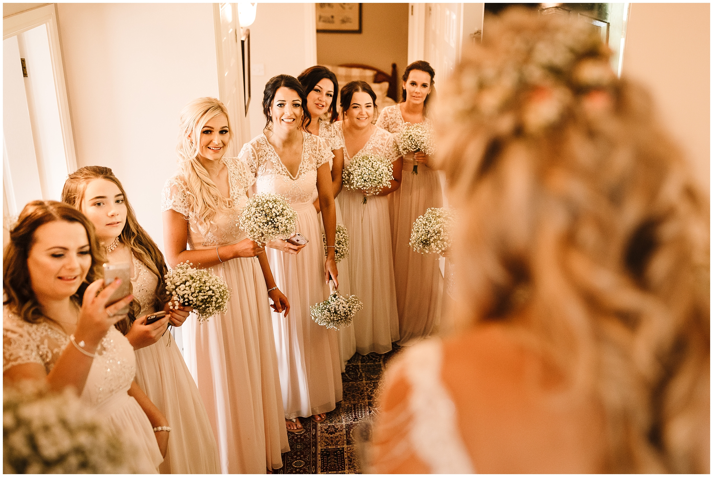 BRIDESMAIDS REACTING TO A BRIDE WALKING OUT FOR THE FIRST TIME