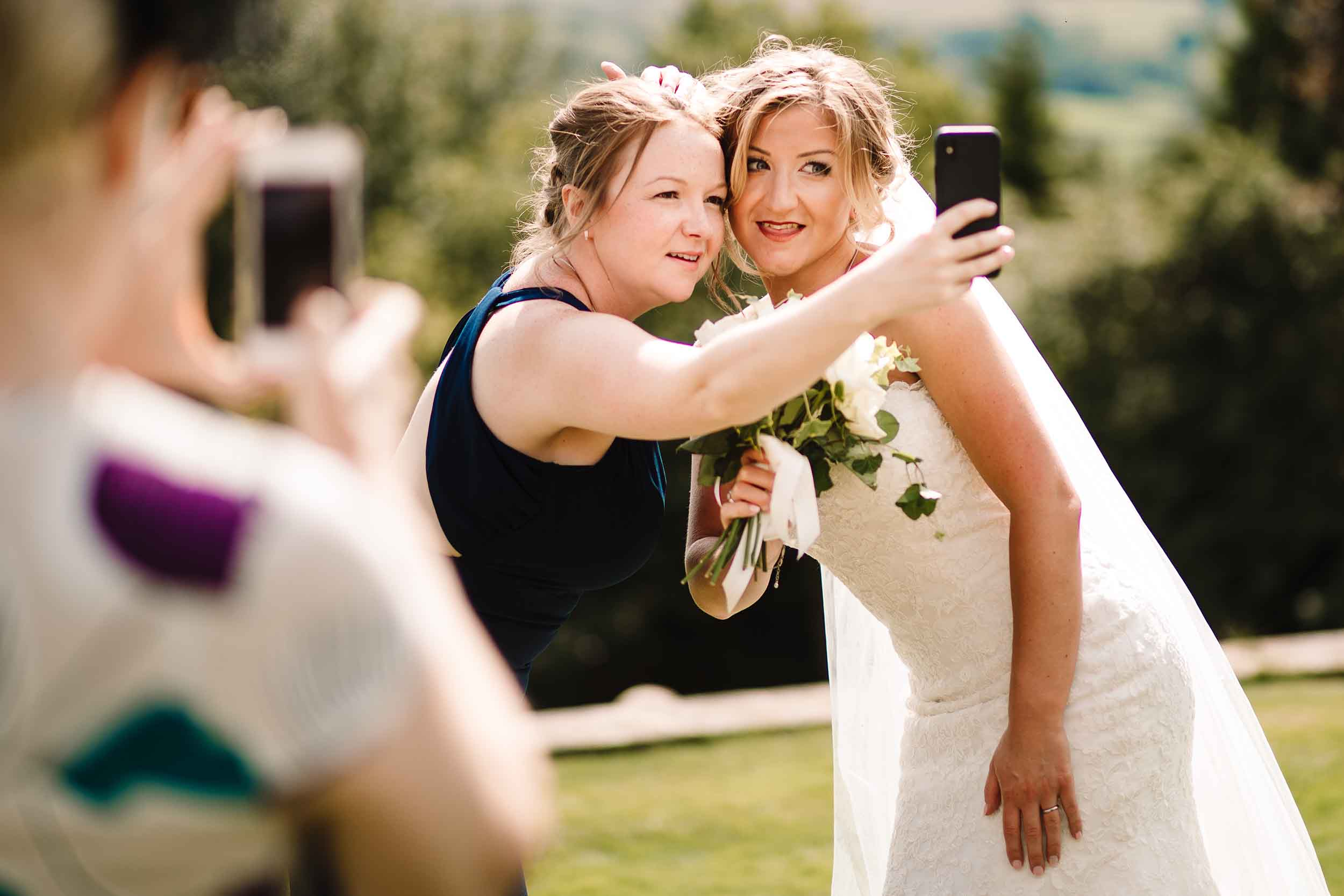 a bride and her sister taking a selfie