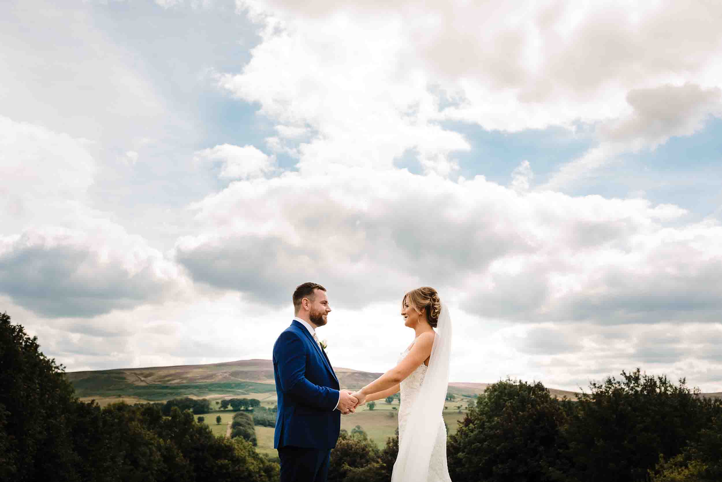 a bride and groom saying their vows outdoors in yorkshire