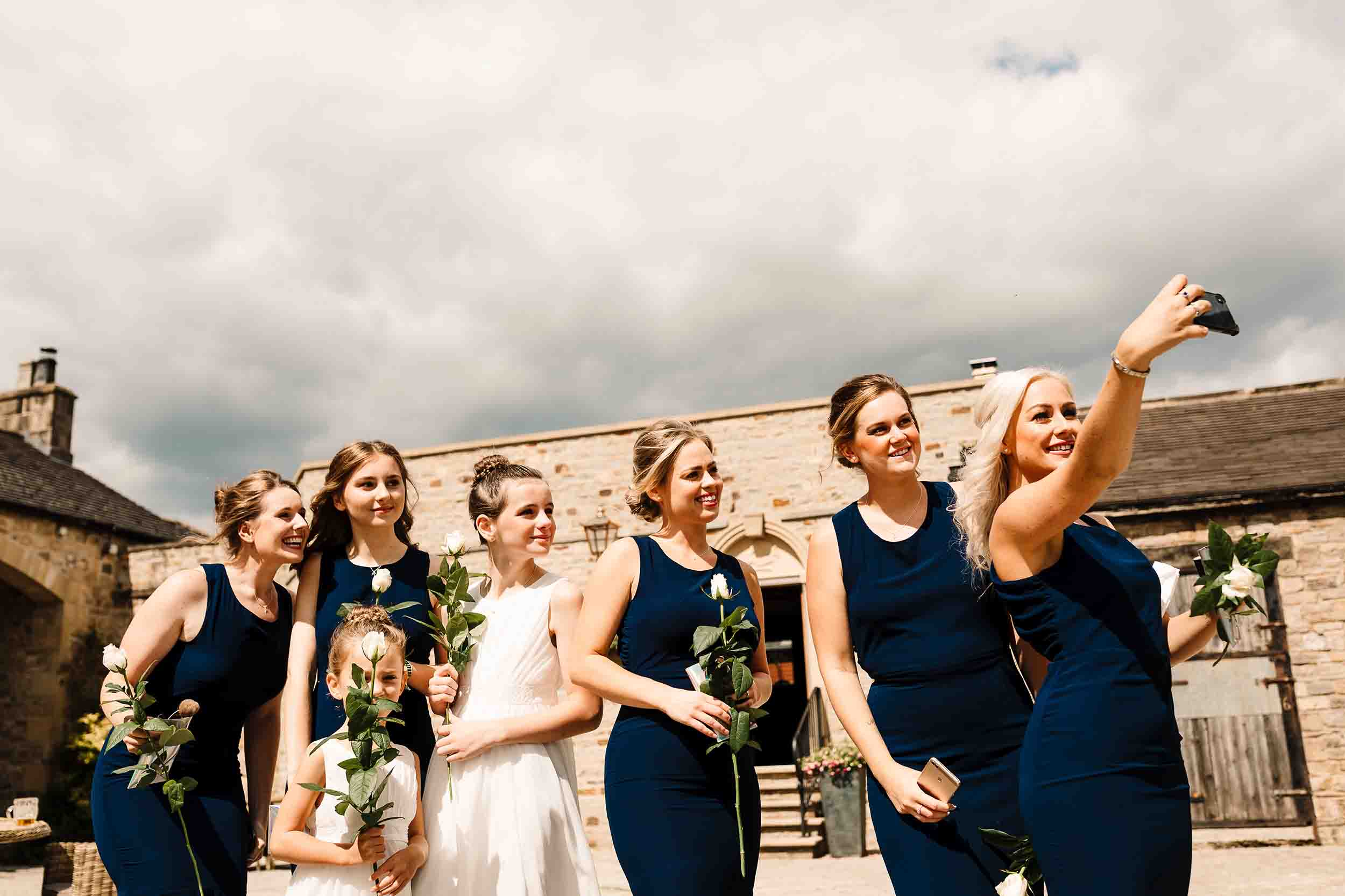 bridesmaids taking a selfie before a wedding ceremony