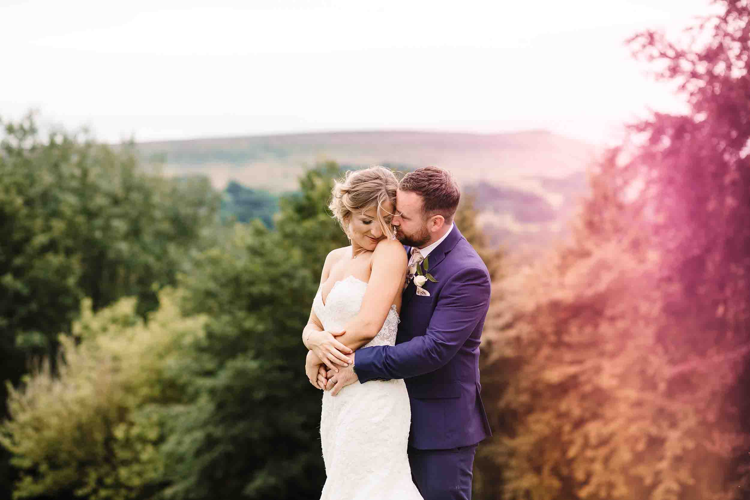 a bride and groom snuggling during a wedding portrait in yorkshire
