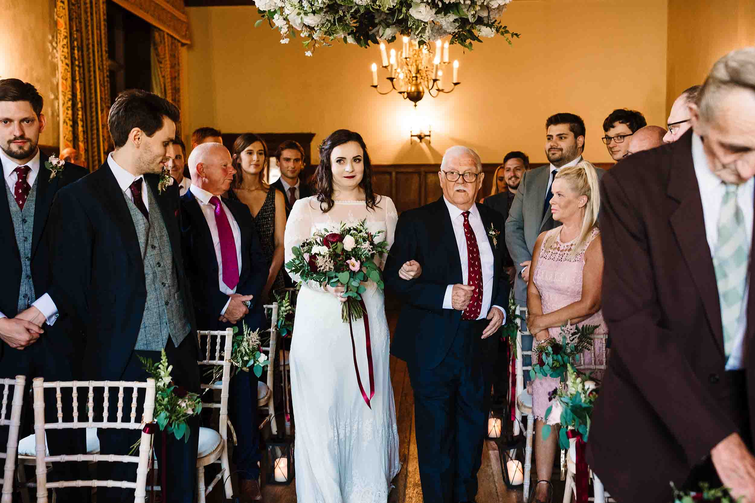 a bride walking down the aisle with her grandad