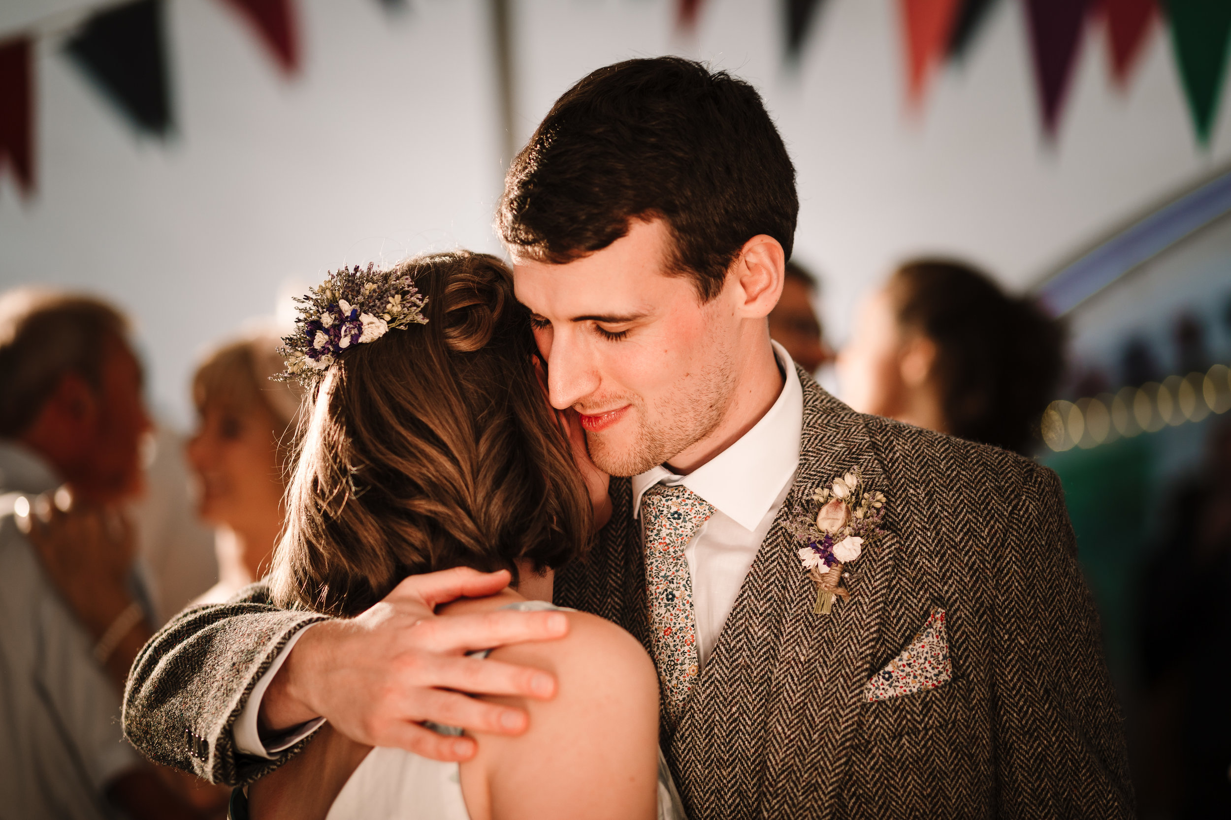 A groom hugging the bride in a marquee in Yorkshire