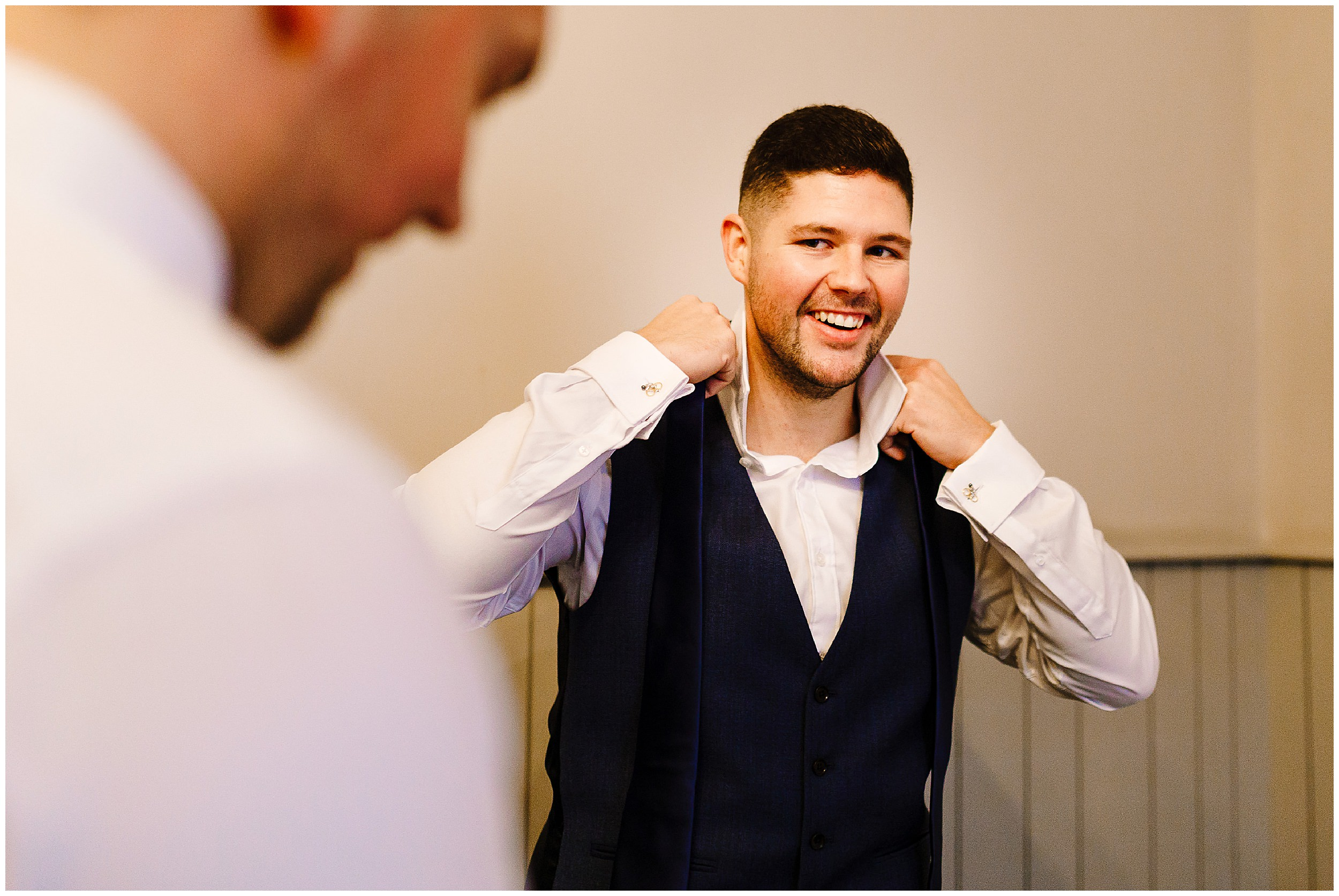 A groom and his best man getting ready