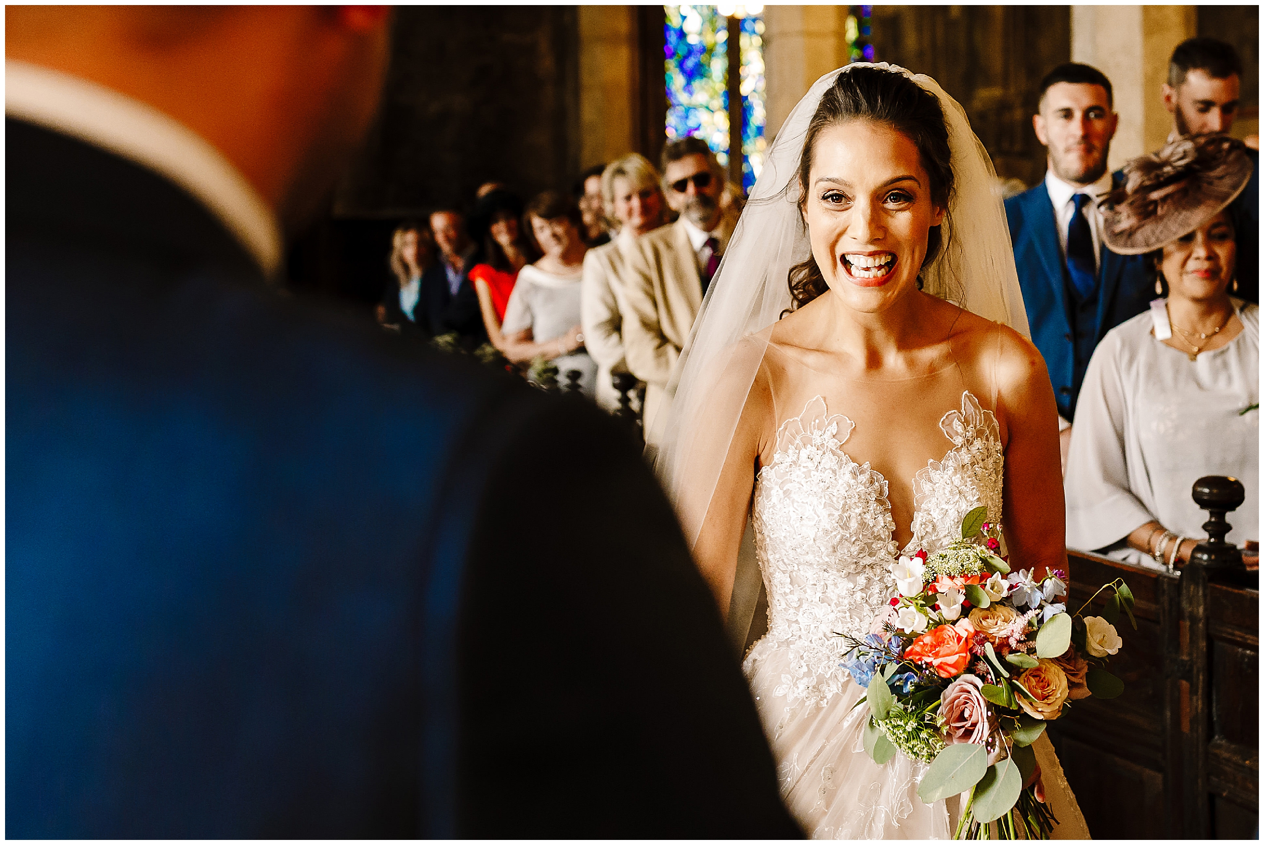 A bride seeing the groom for the first time as she walks down the aisle